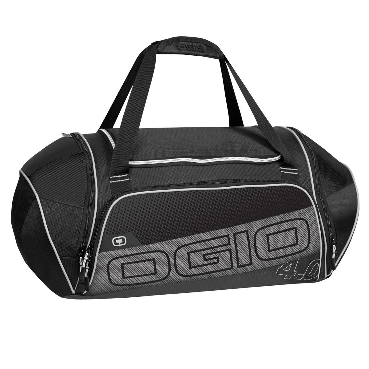 Сумка OGIO Endurance 4.0, цвет: черный, серый. 112037.030MD-533-2/4Сумка Ogio Endurance 4.0 имеет надежную и легкую конструкцию, обладающую высокой устойчивостью к растяжению.Особенности:Складывающаяся система наплечных ремней.Хорошо вентилируемое сетчатое отделение для обуви.Износостойкое и устойчивое к истиранию брезентовое основание.Особое отделение для продуктов питания.Легкая, износоустойчивая и прочная на разрыв ткань.Вместительное основное отделение.Боковой карман с двусторонней застежкой на молнии.Устойчивая к поту, мягкая литая ручка для переноски.Передний карман на молнии для хранения аксессуаров.Большой карман для бутылки с водой.Яркая подкладка.Объем: 47 л. Материал: кареточная ткань 420D, кареточная ткань.