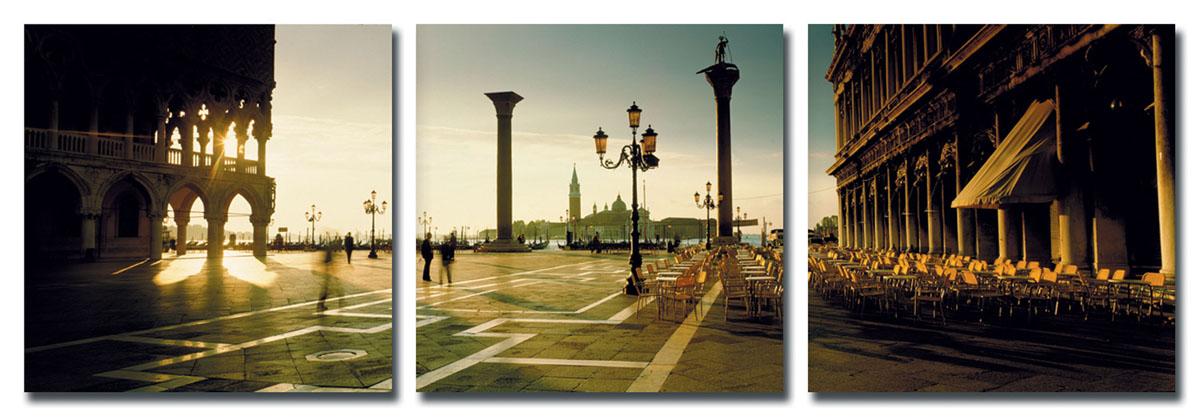 Канвас триптих Idea Площадь Сан-Марко, 150 см х 50 смRG-D31SКанвас - это ткань (полиэстер) с художественной фотопечатью, натянутая на деревянный каркас. Триптих включает три элемента, которые образуют единый рисунок. Такое изделие - оригинальный декоративный элемент, способный преобразить любой интерьер. Картина оформлена красочным изображением площади Сан-Марко в Венеции. С задней стороны имеются петельки для подвешивания к стене. Элементы следует размещать на стене, оставляя между ними небольшой промежуток.Стильный, современный дизайн, а также яркие и насыщенные цвета сделают эту картину прекрасным дополнением интерьера комнаты.