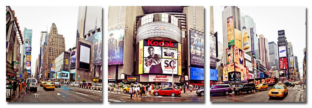 Канвас триптих Idea Город, 150 см х 50 смБрелок для сумкиКанвас - это ткань (полиэстер) с художественной фотопечатью, натянутая на деревянный каркас. Триптих включает три элемента, которые образуют единый рисунок. Такое изделие - оригинальный декоративный элемент, способный преобразить любой интерьер. Картина оформлена красочным изображением главной улицы Нью-Йорка - Пятое Авеню. С задней стороны имеются петельки для подвешивания к стене. Элементы следует размещать на стене, оставляя между ними небольшой промежуток.Стильный, современный дизайн, а также яркие и насыщенные цвета сделают эту картину прекрасным дополнением интерьера комнаты.