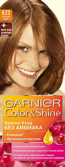 Garnier Краска-уход для волос Color&Shine без аммиака, оттенок 6.23, Лесной орехMP59.4DGarnier Color&Shineкраска-уход, без аммиака, которая не только бережно ухаживает за волосами, делая их мягкими, но и оптимально закрашивает седину. Она обогащена экстрактом клюквы, признанным антиоксидантом, который продлевает сияние цвета Ваших волос надолго. Благодаря питательным свойствам арганового масла Ваши волосы защищены от сухости, а блеск максимально усилен. Ваши волосы несравненно мягкие, цвет сияющий,стойкий в течение 28 использований шампуня. Узнай больше об окрашивании на http://coloracademy.ru/.В упаковки содержится: флакон с молочком-проявителем (60 мл); тюбик с крем-краской (40 мл); крем-уход усилитель блеска после окрашивания; инструкция; пара перчаток.