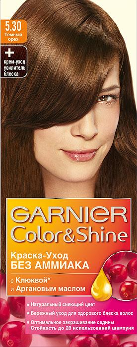 Garnier Краска-уход для волос Color&Shine без аммиака, оттенок 5.30, Темный орехMP59.4DGarnier Color&Shineкраска-уход, без аммиака, которая не только бережно ухаживает за волосами, делая их мягкими, но и оптимально закрашивает седину. Она обогащена экстрактом клюквы, признанным антиоксидантом, который продлевает сияние цвета Ваших волос надолго. Благодаря питательным свойствам арганового масла Ваши волосы защищены от сухости, а блеск максимально усилен. Ваши волосы несравненно мягкие, цвет сияющий,стойкий в течение 28 использований шампуня. Узнай больше об окрашивании на http://coloracademy.ru/.В упаковки содержится: флакон с молочком-проявителем (60 мл); тюбик с крем-краской (40 мл); крем-уход усилитель блеска после окрашивания; инструкция; пара перчаток.