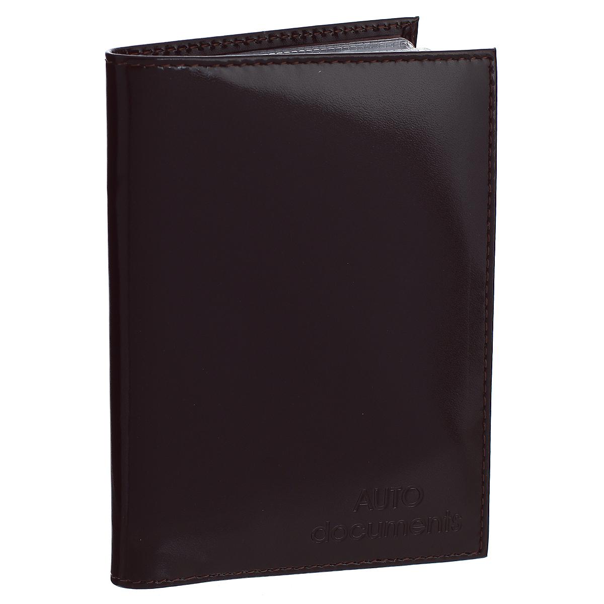 Бумажник водителя Befler Classic, цвет: темно-коричневый. BV.20.-1WTID03Бумажник водителя Befler Classic выполнен из натуральной гладкой кожи. На внутреннем развороте имеет один глубокий вертикальный карман из кожи и 4 прорезных кармашка для кредитных карт и визиток, прозрачный кармашек и внутренний блок для водительских документов из прозрачного пластика (6 карманов).Такой бумажник станет отличным подарком для человека, ценящего качественные и необычные вещи.