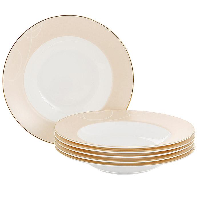 Набор суповых тарелок Esprado El Gracio, диаметр 23 см, 6 шт115510Набор Esprado El Gracio состоит из шести суповых тарелок, выполненных из костяного фарфора. Основная составляющая костяного фарфора - костная зола и каолин. От содержания костной золы зависит белизна и прозрачность фарфора, который может содержать до 50% костяной золы. Родина костной золы, из которой производится посуда Esprado, - Великобритания, славящаяся сырьем высокого качества. Каолин, белая глина на основе природного минерала, поступает из Новой Зеландии, одного из наиболее экологически чистых регионов мира. Такое сочетание обеспечивает высокое качество материала и безупречный оттенок слоновой кости.В костяном фарфоре отсутствуют примеси кадмия и свинца, а потому он абсолютно нетоксичен и безопасен. Экологическая глазурь из Японии, высоко ценящаяся во всем мире, которой покрывается готовое изделие, позволяет добиться идеально ровного цвета и кристального блеска. При декорировании использованы драгоценные металлы, в том числе платина и золото. Изделия серии El Gracio украшены золотой деколью. Посуда имеет классическую форму с бортиками.Посуда из фарфора Esprado прочна и устойчива к истиранию: царапины от ножа и сеточки трещин не появятся на ней даже через несколько лет. Характерные для коллекции El Gracio особенности - асимметрия и плавно изогнутые золотые линии, кажущиеся еще ярче и выразительнее на белом и пастельном фоне, благодаря чему посуда этой серии получилась легкой и воздушной. Каждый предмет отличается своей уникальной деколью, собранные же воедино они образуют оригинальный обеденный сервиз для самых взыскательных и утонченных. Столовая посуда El Gracio придаст особую неповторимость вашему столу.Запрещается использовать в микроволновой печи, мыть в посудомоечной машине и использовать абразивные моющие средства.