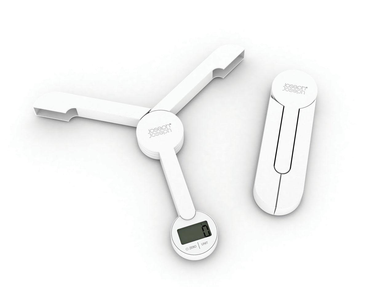 Весы кухонные Joseph Joseph TriScale, складные, цвет: белый, до 5 кгKS 3207Кухонные весы Joseph Joseph TriScale позволят вам взвесить с точностью до грамма продукты весом до 5 кг. Корпус весов выполнен из прочного пластика, снабжен 3 сенсорами. Весы оснащены прямоугольным электронным дисплеем. Основание весов имеет три устойчивые ножки с нескользящим покрытием. На корпусе расположены две сенсорные кнопки управления: кнопка включения/отключения и кнопка выбора единицы измерения Unit. Измерять можно как сыпучие продукты, так и жидкости. В весах предусмотрено 5 единиц измерения - граммы (g), миллилитры (ml), фунты (lb), унции (oz), жидкие унции (fl.oz). Если вы не используете весы более 5 минут, они отключатся автоматически. Имеется функция довеса.Весы складные (в сложенном виде занимают минимум места), это поможет сэкономить пространство на кухне. С помощью таких цифровых весов можно точно контролировать пропорции ингредиентов. Кухонные весы Joseph Joseph TriScale придутся по душе каждой хозяйке и станут незаменимым аксессуаром на кухне.