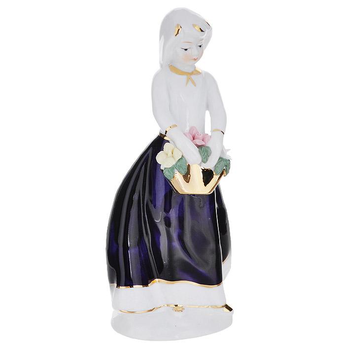 Фигурка декоративная Molento Софи, высота 20 см514-1046Декоративная фигурка Molento Софи, изготовленная из высококачественного фарфора, выполнена в виде девушки. Такая фигурка станет отличным дополнением к интерьеру.Вы можете поставить фигурку в любом месте, где она будет удачно смотреться, и радовать глаз. Кроме того, фигурка Софи станет чудесным сувениром для ваших друзей и близких.