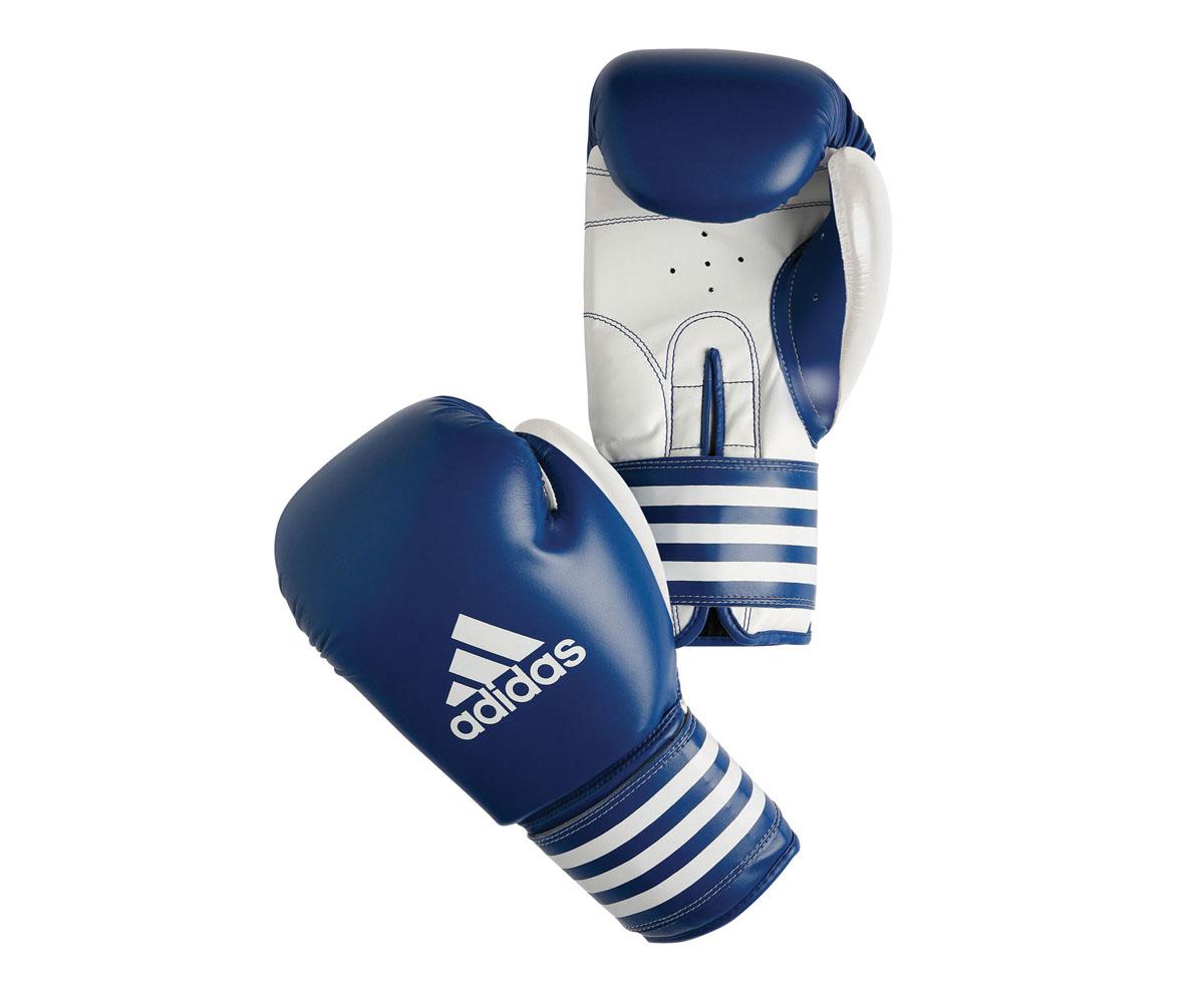 Перчатки боксерские adidas Ultima Competition, цвет: сине-белый. adiBC02adiBT021Боксерские перчатки adidas Ultima Competition для отработок ударов и комбинаций. Тыльная сторона в перчатках выполнена из прочной, износостойкой, натуральной кожи. Внутренний наполнитель, выполненный из формованной под давлением пены с интегрированной внутренней вставкой из геля, выполненной по технологии I-Protech, покрывает тыльную сторону, создавая надежную защиту рук и давая боксеру возможность безопасно тренироваться в полную силу. Внутренняя подкладка, выполненная из дышащего материала, и вентиляционное отверстие на ладони создают комфортный микроклимат внутри перчаток. Эластичный ремешок с фиксацией на липучке позволяет быстро одеть и снять перчатки.