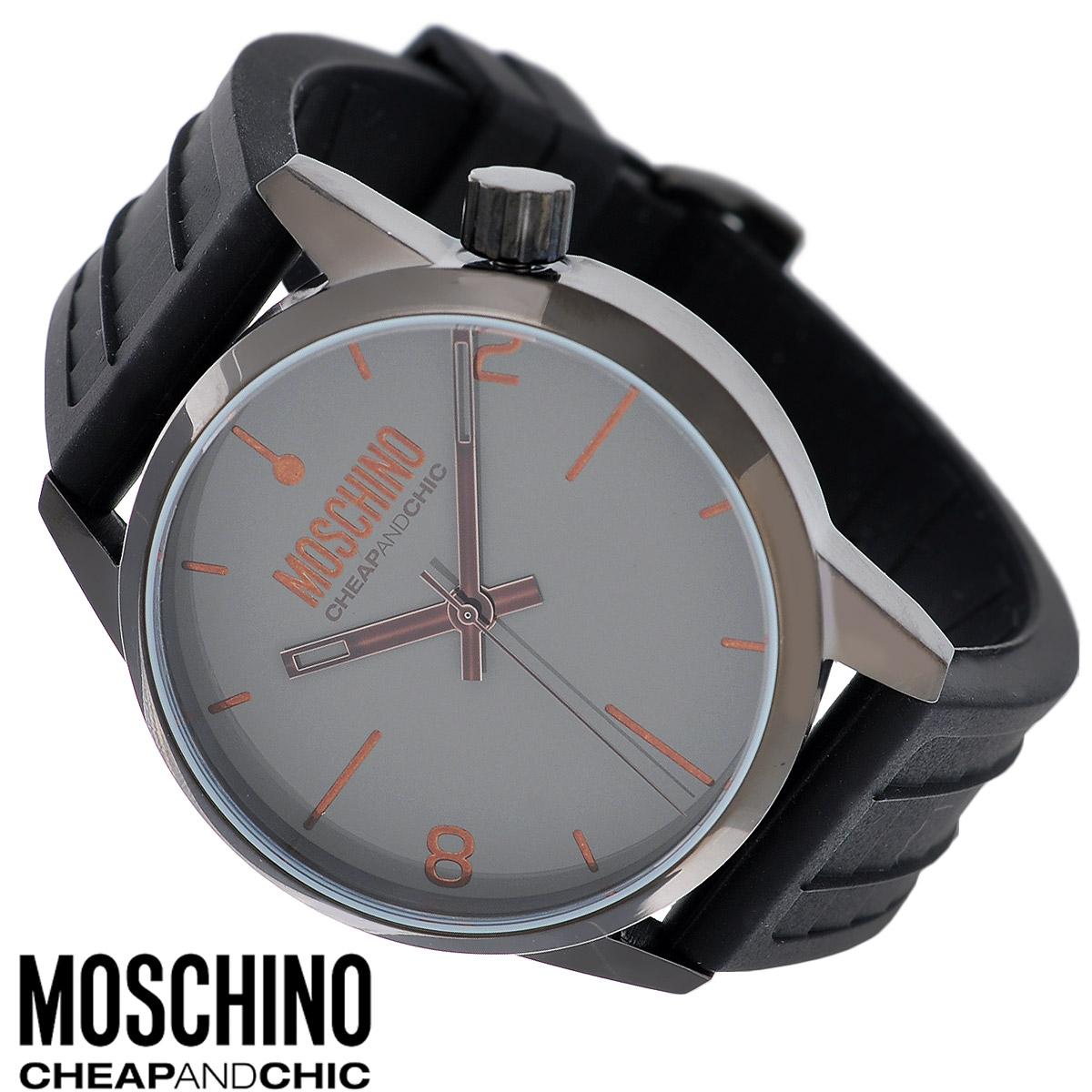 Часы наручные Moschino, цвет: черный, серый. MW027023008Наручные часы от известного итальянского бренда Moschino - это не только стильный и функциональный аксессуар, но и современные технологи, сочетающиеся с экстравагантным дизайном и индивидуальностью. Часы Moschino оснащены кварцевым механизмом. Корпус круглой формы выполнен из высококачественной нержавеющей стали с PVD-покрытием. Циферблат с отметками и арабскими цифрами защищен минеральным стеклом. Часы имеют три стрелки - часовую, минутную и секундную. Ремешок часов выполнен из каучука и оснащен классической застежкой.Часы упакованы в фирменную металлическую коробку с логотипом бренда. Часы Moschino благодаря своему уникальному дизайну отличаются от часов других марок своеобразными циферблатами, функциональностью, а также набором уникальных технических свойств. Каждой модели присуща легкая экстравагантность, самобытность и, безусловно, великолепный вкус. Характеристики: Диаметр циферблата: 4 см.Размер корпуса: 4,5 см х 4,5 см х 1,3 см.Длина ремешка (с корпусом): 25,5 см.Ширина ремешка: 2,3 см.