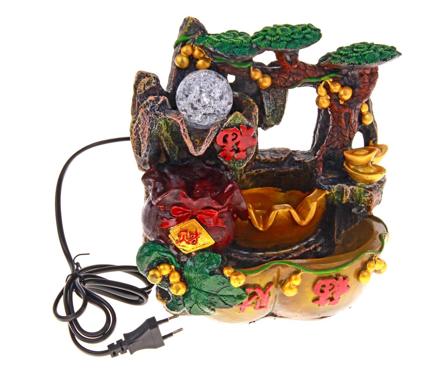 Фонтан Sima-land Фэн-шуй к богатству54 009312Фонтан Sima-land Фэн-шуй к богатству изготовлен из высококачественного полистоуна. Фонтан выполнен в виде композиции из деревьев, мешка и иероглифов. Журчание и вид воды, стекающей струями из миниатюрного фонтана, могут изменить облик вашего дома и сада, создавая атмосферу покоя. Вода в фонтане циркулирует при помощи электрического погружного центробежного насоса, входящего в комплект. Интерьерный фонтан хорошо увлажняет воздух, благотворно воздействуя на наш организм и создавая здоровый климат. УВАЖАЕМЫЕ КЛИЕНТЫ! Обращаем ваше внимание на то, что фонтан работает от сети 220V. Материал: Полистоун, стекло 1%, 220V