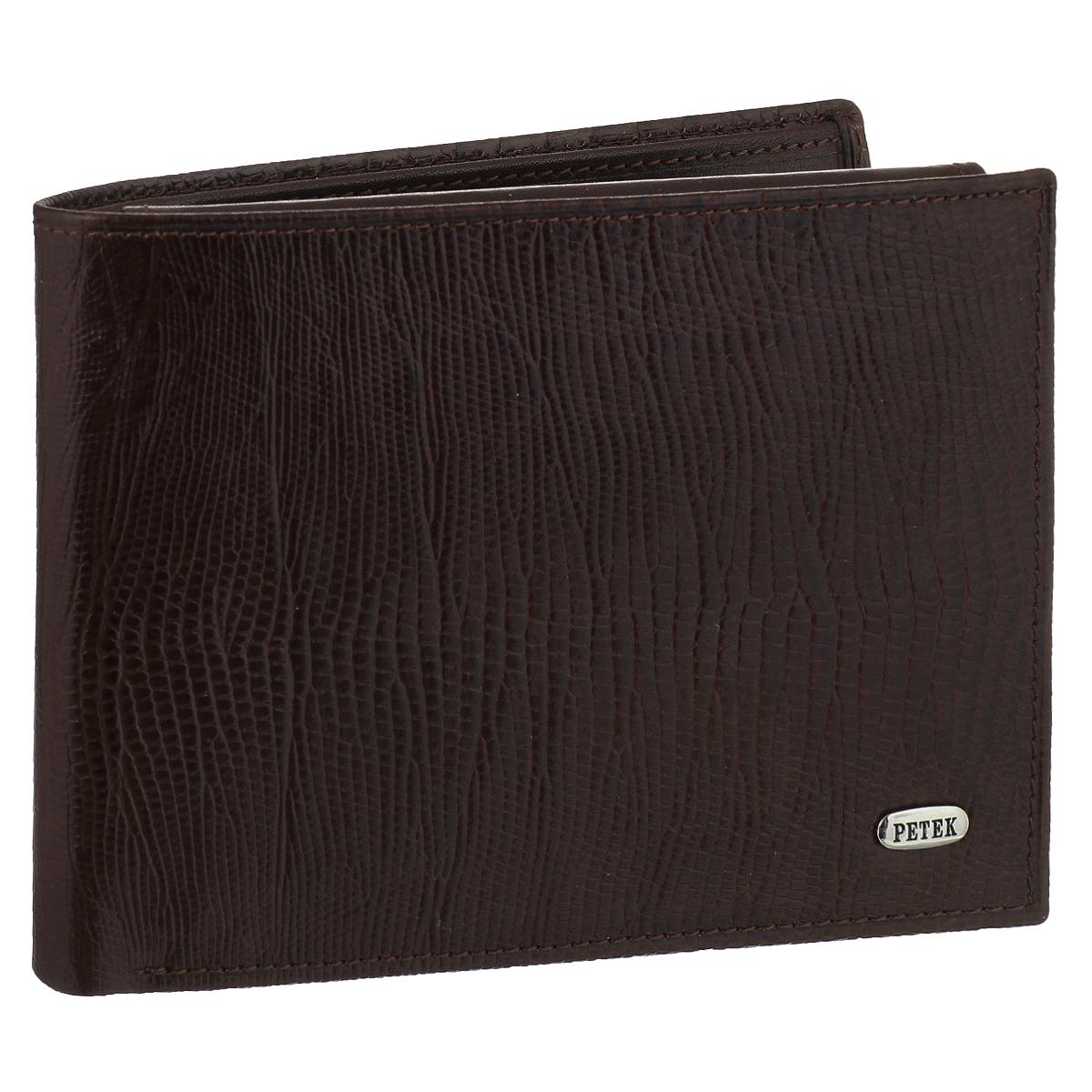 Портмоне Petek, цвет: темно-коричневый. 169.041.02BM8434-58AEСтильное портмоне Petekвыполнено из натуральной кожи с декоративным тиснением под питона.Внутри - два отделения для купюр, 12 наборных кармашков для пластиковых карт, карман с сетчатой вставкой для фото и четыре кармана для мелких бумаг и чеков. Изделие упаковано в коробку с логотипом брэнда. Такое портмоне станет замечательным подарком человеку, ценящему качественные и полезные вещи.