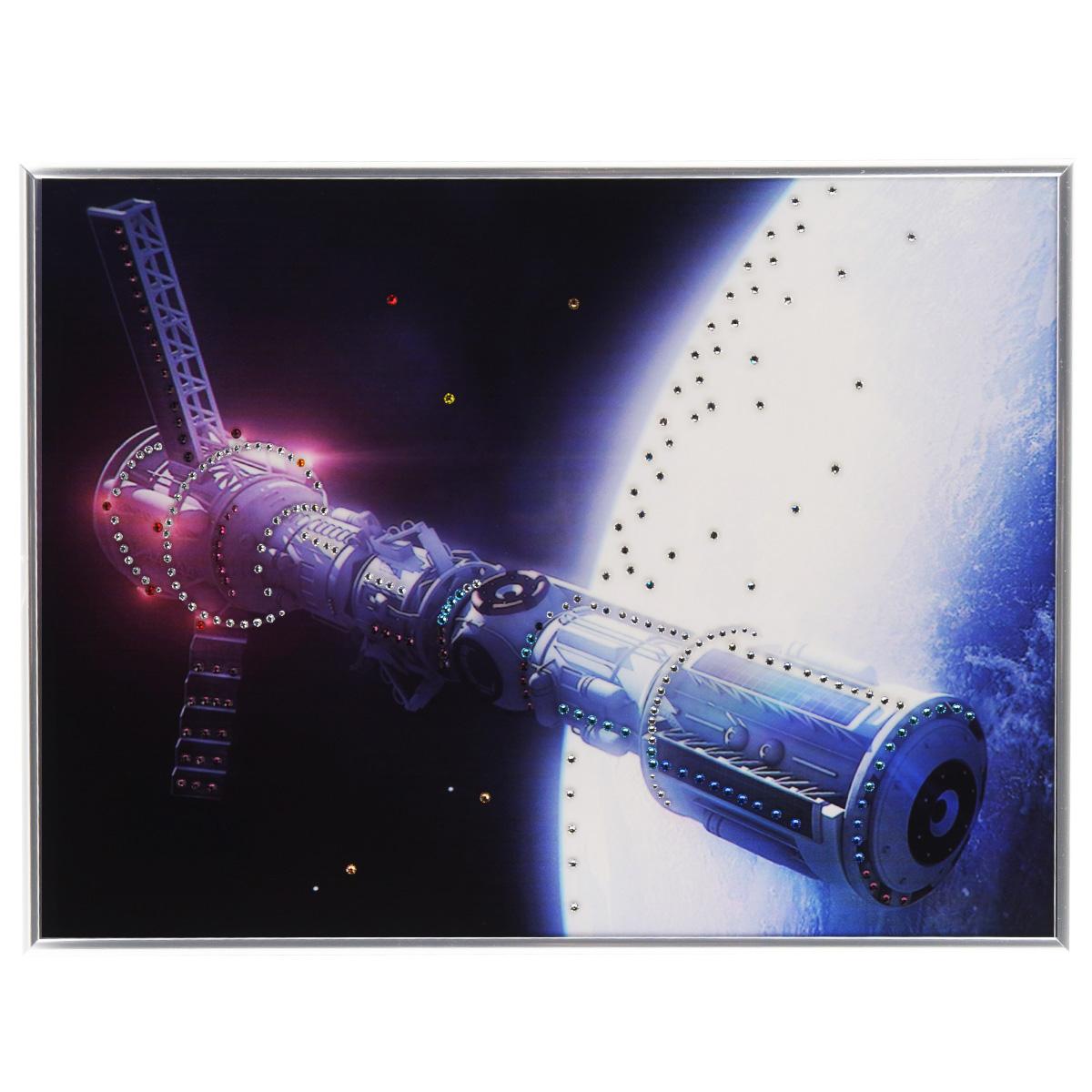 Картина с кристаллами Swarovski В космосе, 40 см х 30 смPM-3304Изящная картина в металлической раме, инкрустирована кристаллами Swarovski, которые отличаются четкой и ровной огранкой, ярким блеском и чистотой цвета. Красочное изображение космического корабля, расположенное под стеклом, прекрасно дополняет блеск кристаллов. С обратной стороны имеется металлическая петелька для размещения картины на стене. Картина с кристаллами Swarovski В космосе элегантно украсит интерьер дома или офиса, а также станет прекрасным подарком, который обязательно понравится получателю. Блеск кристаллов в интерьере, что может быть сказочнее и удивительнее. Картина упакована в подарочную картонную коробку синего цвета и комплектуется сертификатом соответствия Swarovski.