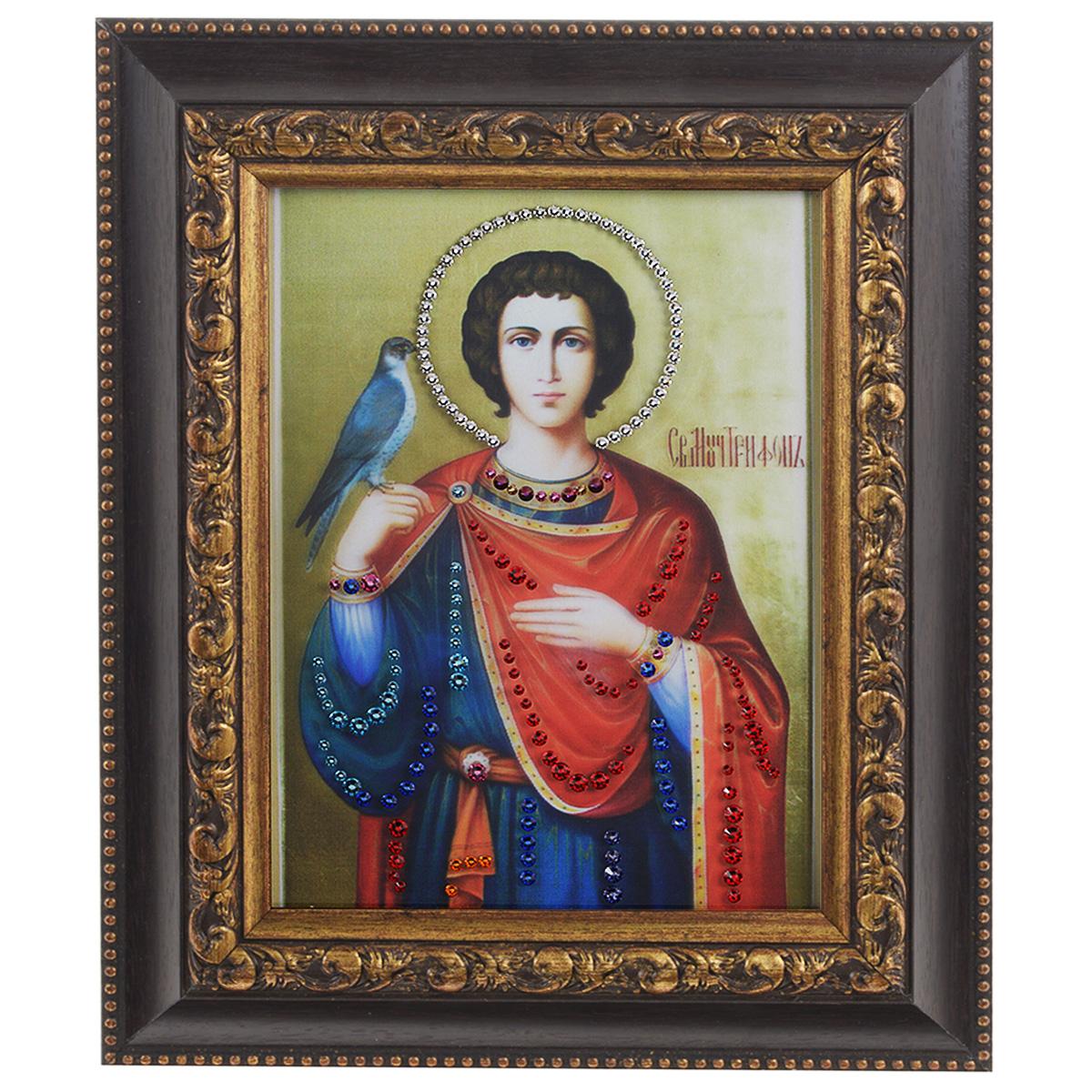 Картина с кристаллами Swarovski Икона. Святой Трифон, 22,5 см х 27,5 смIDEA FL2-05Изящная картина в багетной раме, инкрустирована кристаллами Swarovski, которые отличаются четкой и ровной огранкой, ярким блеском и чистотой цвета. Красочное изображение иконы - Святой Трифон, расположенное на внутренней стороне стекла, прекрасно дополняет блеск кристаллов. С обратной стороны имеется металлическая проволока для размещения картины на стене. Картина с кристаллами Swarovski Икона. Святой Трифон элегантно украсит интерьер дома или офиса, а также станет прекрасным подарком, который обязательно понравится получателю. Блеск кристаллов в интерьере, что может быть сказочнее и удивительнее. Картина упакована в подарочную картонную коробку синего цвета и комплектуется сертификатом соответствия Swarovski.