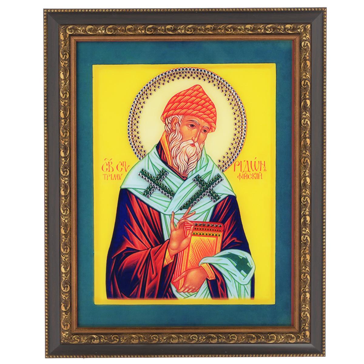 Картина с кристаллами Swarovski Икона. Святитель Спиридон Тримифудский, 37,5 см х 47,5 см12723Изящная картина в багетной раме, инкрустирована кристаллами Swarovski, которые отличаются четкой и ровной огранкой, ярким блеском и чистотой цвета. Красочное изображение Иконы Святитель Спиридон Тримифудский, расположенное под стеклом, прекрасно дополняет блеск кристаллов. С обратной стороны имеется металлическая проволока для размещения картины на стене. Картина с кристаллами Swarovski Икона. Святитель Спиридон Тримифудский элегантно украсит интерьер дома или офиса, а также станет прекрасным подарком, который обязательно понравится получателю. Блеск кристаллов в интерьере, что может быть сказочнее и удивительнее. Картина упакована в подарочную картонную коробку синего цвета и комплектуется сертификатом соответствия Swarovski.