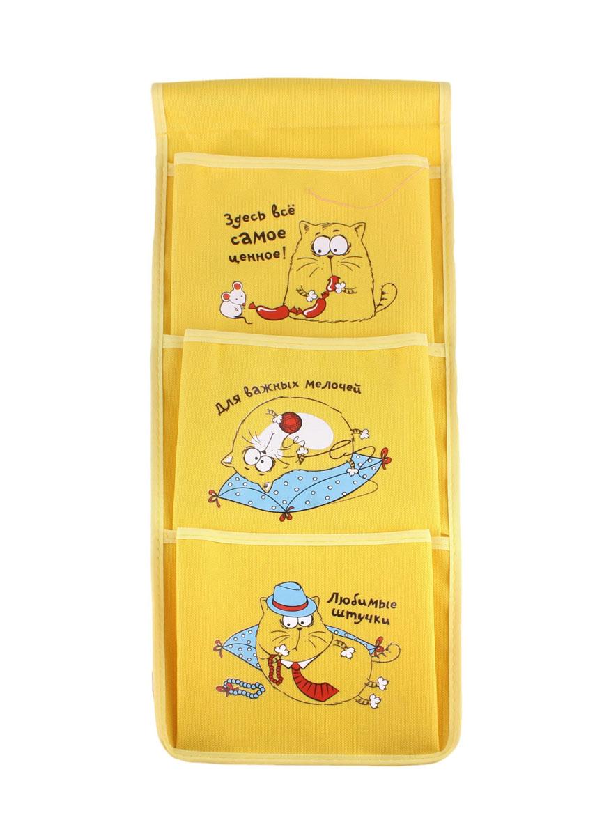 Кармашки на стену Sima-land Самое ценное, цвет: желтый, голубой, красный, 3 штRG-D31SКармашки на стену Sima-land «Самое ценное», изготовленные из текстиля и пластика, предназначены для хранения необходимых вещей, множества мелочей в гардеробной, ванной, детской комнатах. Изделие представляет собой текстильное полотно с тремя пришитыми кармашками. Благодаря пластмассовой планке и шнурку, кармашки можно подвесить на стену или дверь в необходимом для вас месте. Кармашки декорированы изображениями забавного кота в разных смешных ситуациях.Этот нужный предмет может стать одновременно и декоративным элементом комнаты. Яркий дизайн, как ничто иное, способен оживить интерьер вашего дома.