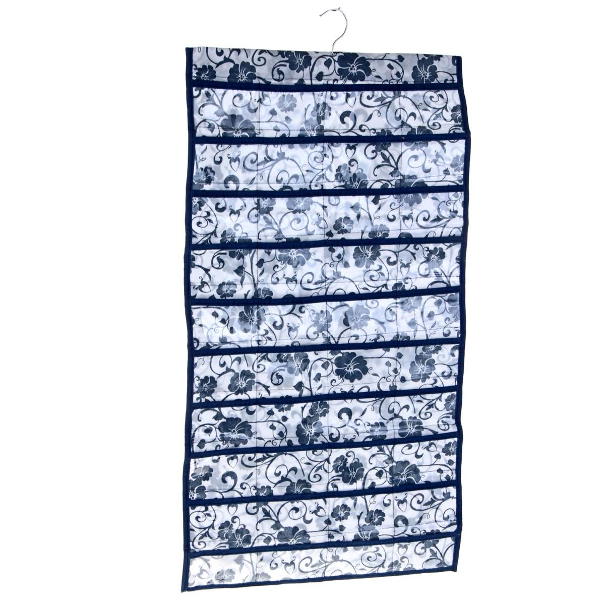 Органайзер для хранения вещей Sima-land с вешалкой, цвет: синий, 80 отделенийTD 0033Органайзер Sima-land, изготовленный из ПВХ и текстиля, предназначен для хранения необходимых вещей, множества мелочей в гардеробной, ванной, детской комнатах. Изделие представляет собой текстильное полотно с 80 пришитыми кармашками. Благодаря металлической вешалке, органайзер можно подвесить на стену или дверь в необходимом для вас месте. Органайзер декорирован цветочным принтом.Этот нужный предмет может стать одновременно и декоративным элементом комнаты. Яркий дизайн, как ничто иное, способен оживить интерьер вашего дома.