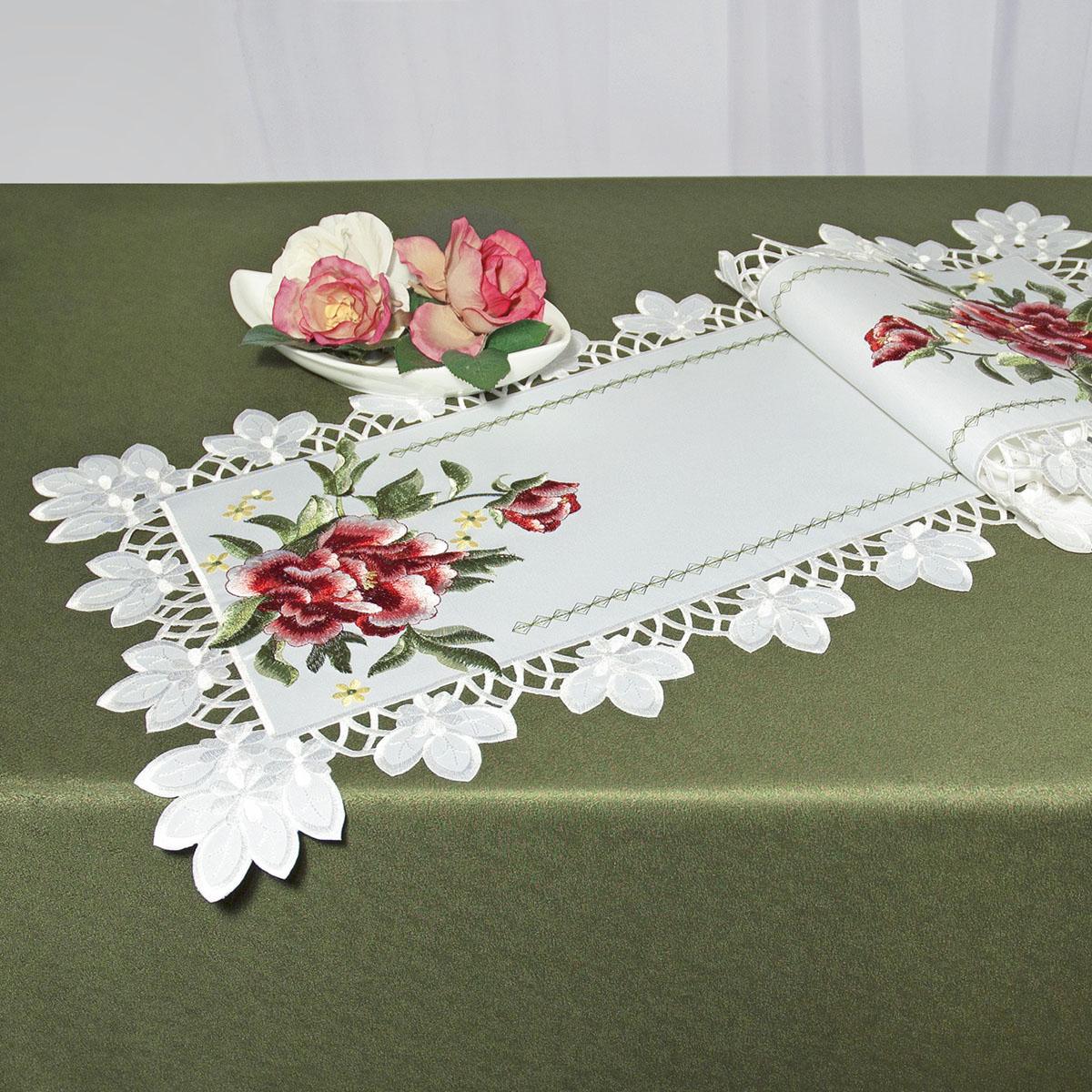 Дорожка для декорирования стола Schaefer, прямоугольная, цвет: белый, красный, 40 x 110 см 07481-23361709Дорожка Schaefer выполнена из высококачественного полиэстера и украшена вышитыми рисунками в виде цветов. Края дорожки оформлены в технике ришелье. Вы можете использовать дорожку для декорирования стола, комода или журнального столика.Благодаря такой дорожке вы защитите поверхность мебели от воды, пятен и механических воздействий, а также создадите атмосферу уюта и домашнего тепла в интерьере вашей квартиры. Изделия из искусственных волокон легко стирать: они не мнутся, не садятся и быстро сохнут, они более долговечны, чем изделия из натуральных волокон.Изысканный текстиль от немецкой компании Schaefer - это красота, стиль и уют в вашем доме. Дорожка органично впишется в интерьер любого помещения, а оригинальный дизайн удовлетворит даже самый изысканный вкус. Дарите себе и близким красоту каждый день!