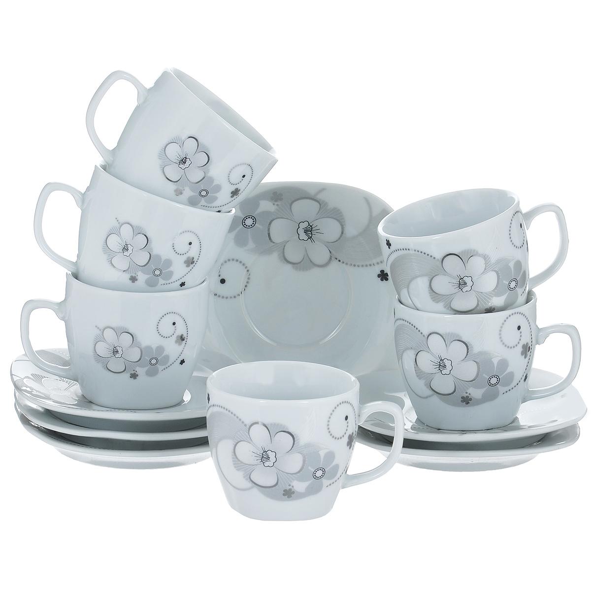 Набор кофейный Bekker, 12 предметов595-200Набор кофейный Bekker состоит из 6 чашек и 6 блюдец. Чашки и блюдца изготовлены из высококачественного фарфора с изображением цветов. Такой дизайн, несомненно, придется по вкусу и ценителям классики, и тем, кто предпочитает утонченность и изящность. Набор кофейный на подставке Bekkerукрасит ваш кухонный стол, а также станет замечательным подарком к любому празднику. Набор упакован в подарочную коробку из плотного цветного картона. Внутренняя часть коробки задрапирована белой атласной тканью, и каждый предмет надежно крепится в определенном положении благодаря особым выемкам в коробке. Можно мыть в посудомоечной машине.