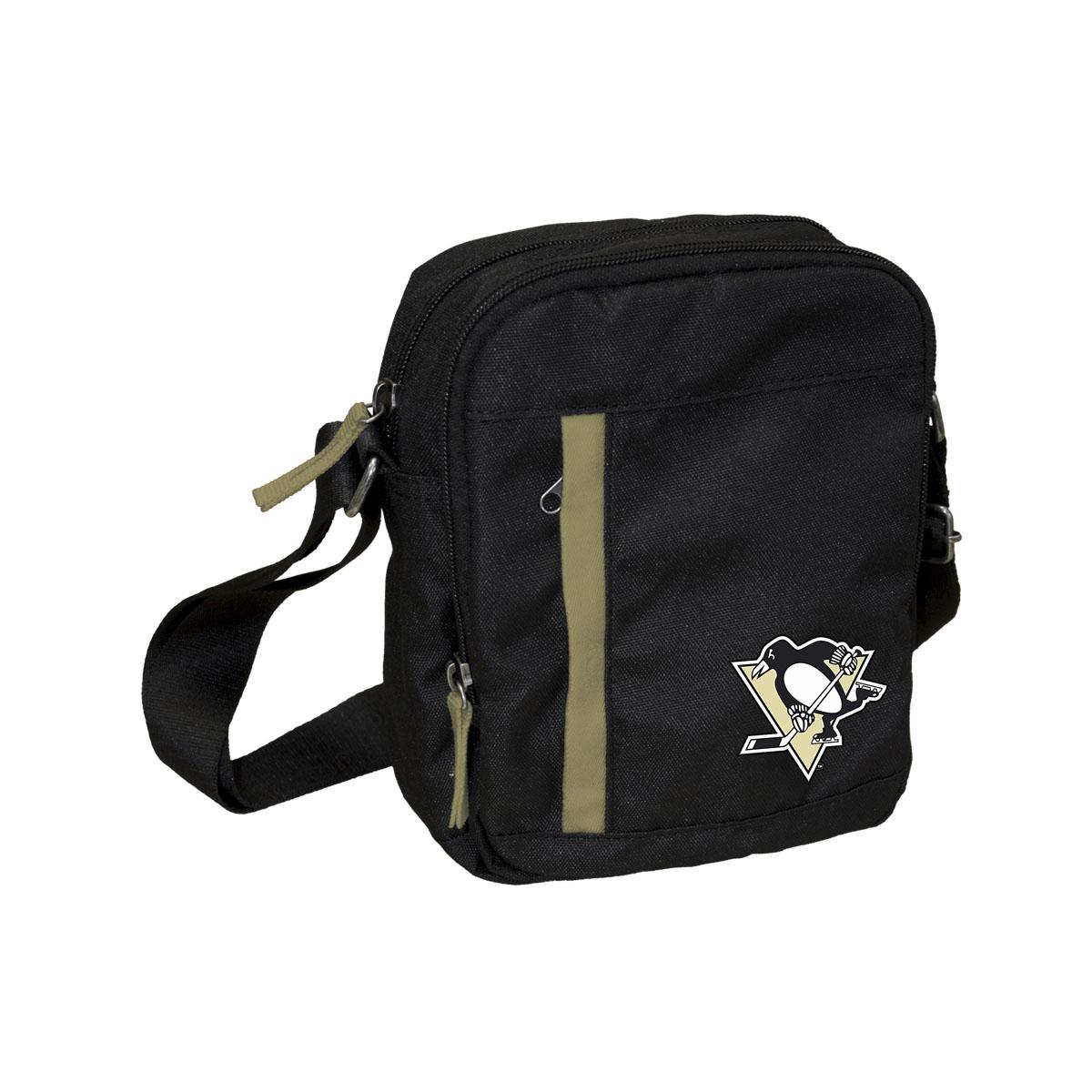 Сумка на ремне NHL Penguins, цвет: черный, 3,5 л. 5801858019Универсальная сумка NHL Penguins на регулируемом плечевом ремне имеет два отделения на молнии. Внешний карман на молнии отделан контрастной полосой. Основное отделение содержит четыре небольших кармана для мелочей, один из них на молнии. Сумка украшена эмблемой хоккейной команды Penguins.