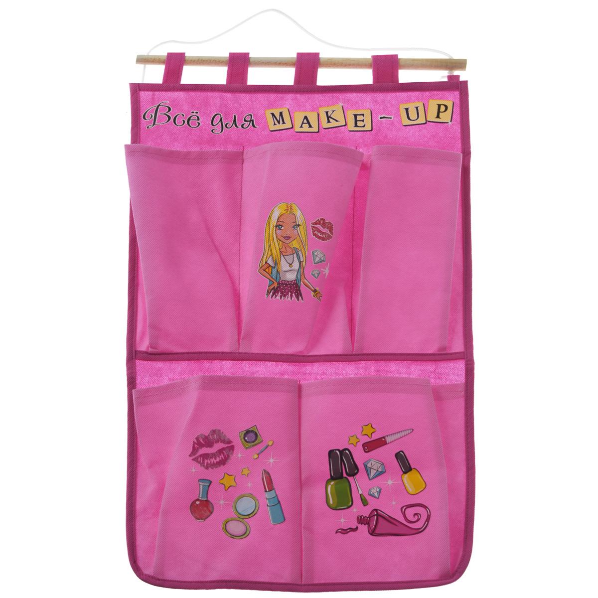 Кармашки на стену Sima-land Все для make-up, цвет: розовый, 5 штES-412Кармашки на стену Sima-land Все для make-up, изготовленные из текстиля, предназначены для хранения необходимых вещей, множества мелочей в гардеробной, ванной, детской комнатах. Изделие представляет собой текстильное полотно с 5 пришитыми кармашками. Благодаря деревянной планке и шнурку, кармашки можно подвесить на стену или дверь в необходимом для вас месте.Кармашки декорированы изображением девушки и различной косметики.Этот нужный предмет может стать одновременно и декоративным элементом комнаты. Яркий дизайн, как ничто иное, способен оживить интерьер вашего дома.