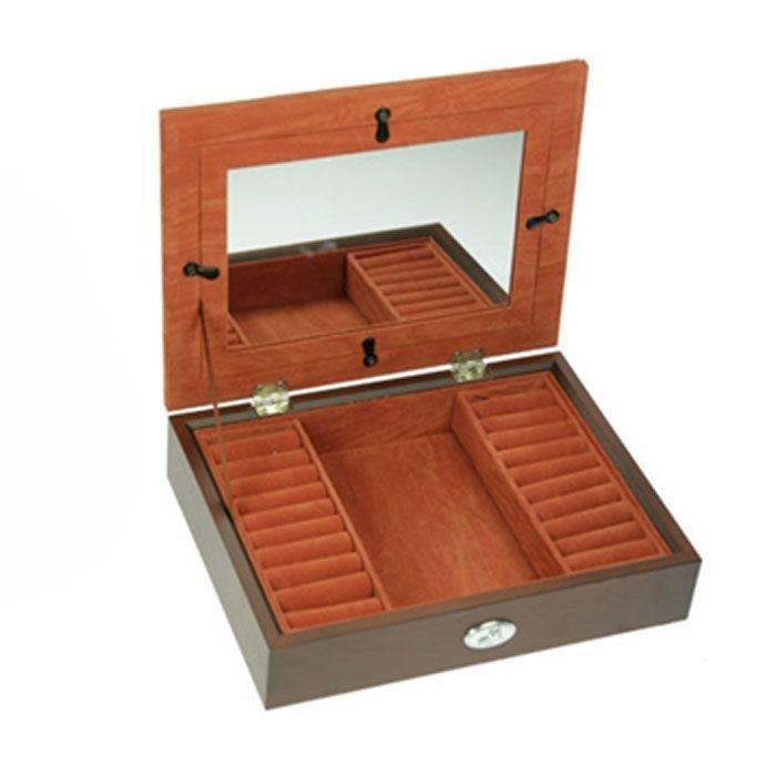 Шкатулка ювелирная Moretto, цвет: коричневый, 21,5 см х 16,5 см х 5 см444012Ювелирная шкатулка Moretto, выполненная из МДФ и алюминия, украсит интерьер любого помещения и позволит компактно и удобно хранить ювелирные изделия и бижутерию. Внутри шкатулки предусмотрено одно отделение, справа и слева которого расположены по одному ряду валиков для хранения колец; на крышке расположено зеркало, под которое можно поместить фотографию. Внутренняя поверхность шкатулки оформлена бархатистым текстилем, выполненным под замшу, что придает шкатулке шарм и изысканность. Нижняя часть шкатулки с внешней стороны также обтянута бархатистым текстилем, что предотвращает истирание поверхности стола. Классический дизайн и функциональность делают шкатулку Moretto практичным и стильным подарком для любой женщины. Характеристики:Материал: МДФ, металл (алюминий), стекло, текстиль, ПМ. Размер шкатулки: 21,5 см х 16,5 см х 5 см. Размер отделения шкатулки (Д х Ш х Г): 8,5 см х 14 см х 3 см. Размер зеркала: 15,5 см х 10 см. Размер фотографии для фоторамки: 18 см х 13 см. Размер фоторамки: 16,5 см х 11,5 см. Размер упаковки: 23 см х 19 см х 7 см. Артикул: 39857.