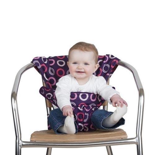 """Дорожный детский стульчик """"Totseat"""" - незаменимая вещь в дороге или в гостях, если вы решили покормить малыша, а под рукой нет детского стульчика. Это компактный стульчик для кормления, предназначенный для детей от 6 до 30 месяцев, подходит для любого обычного стула со спинкой и легко поместиться в женскую сумочку. """"Totseat"""" - это отличный подарок и полезный аксессуар в поездке. Вы можете взять его на пикник и посадить кроху отдыхать в шезлонге. А дополнительная упаковочная сумочка на молнии отлично подойдет для мокрого слюнявчика!"""