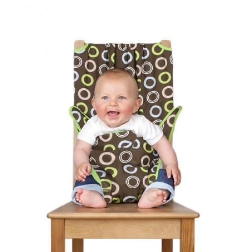 """Дорожный детский стульчик """"Totseat"""" - незаменимая вещь в дороге или в гостях, если вы решили покормить малыша, а под рукой нет детского стульчика. Это компактный стульчик для кормления, предназначенный для детей от 6 до 30 месяцев, подходит для любого обычного стула со спинкой и легко поместится в женскую сумочку. """"Totseat"""" - это отличный подарок и полезный аксессуар в поездке. Вы можете взять его на пикник и посадить кроху отдыхать в шезлонге. А дополнительная упаковочная сумочка на молнии отлично подойдет для мокрого слюнявчика!"""