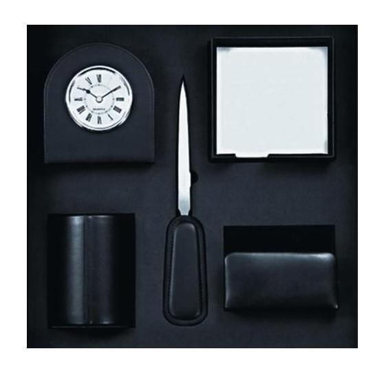 """Настольный офисный набор """"Premium"""" - изысканный набор для стильного интерьера, который станет прекрасным подарком для современного преуспевающего человека, следующего последним тенденциям моды и стремящегося к элегантности и комфорту в каждой детали. Набор выполнен из натуральной кожи черного цвета и включает в себя карандашницу, подставку для писем и визиток, лоток для бумажных блоков, нож для писем и часы."""