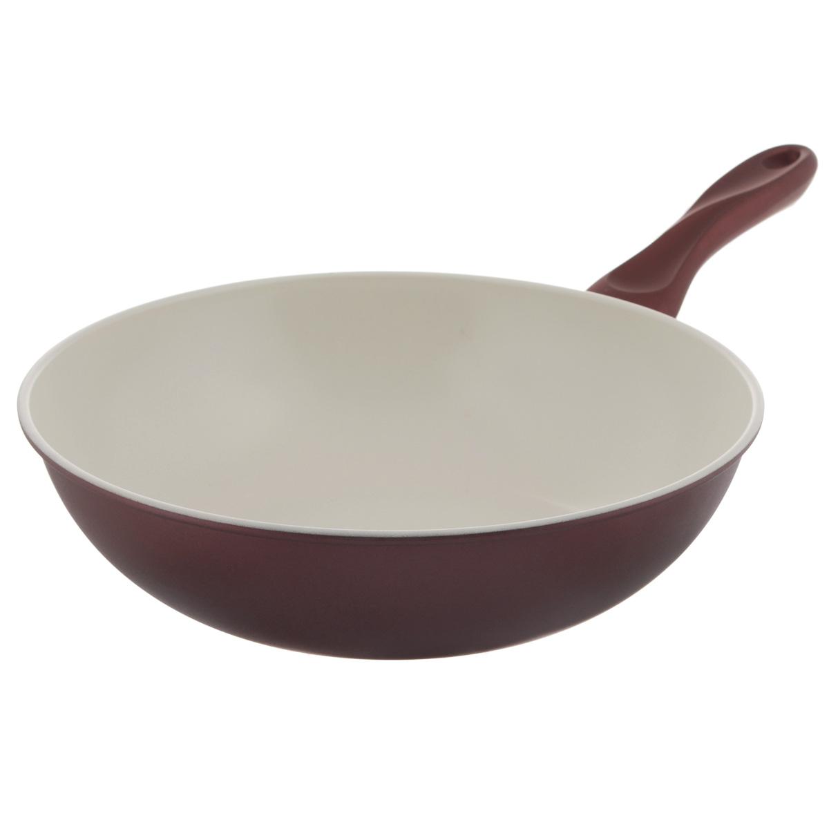 Сковорода-вок Mayer & Boch, с керамическим покрытием, цвет: коричневый, перламутровый. Диаметр 30 смFS-80299Сковорода Вок Mayer & Boch изготовлена из углеродистой стали с высококачественным керамическим покрытием. Керамика не содержит вредных примесей ПФОК, что способствует здоровому и экологичному приготовлению пищи. Кроме того, с таким покрытием пища не пригорает и не прилипает к стенкам, поэтому можно готовить с минимальным добавлением масла и жиров. Гладкая, идеально ровная поверхность сковороды легко чистится, ее можно мыть в воде руками или вытирать полотенцем. Эргономичная ручка специального дизайна выполнена из силикона.Сковорода подходит для использования на газовых и электрических плитах. Также изделие можно мыть в посудомоечной машине. Диаметр: 30 см. Высота стенки: 8 см. Толщина стенки: 1,2 мм. Толщина дна: 2 мм. Длина ручки: 19 см. Диаметр дна: 19 см.