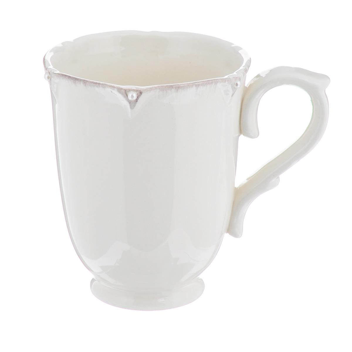 Кружка Lillo Ideal, 350 мл115510Кружка Lillo Ideal выполнена из высококачественной керамики. Края кружки рельефные и декорированы искусственным жемчугом. Такая кружка порадует вас дизайном и функциональностью, а пить чай или кофе из нее станет еще приятнее. Остерегайтесь сильных ударов. Не применять абразивные чистящие средства. Объем: 350 мл.Диаметр кружки по верхнему краю: 9 см.Высота кружки: 11 см.