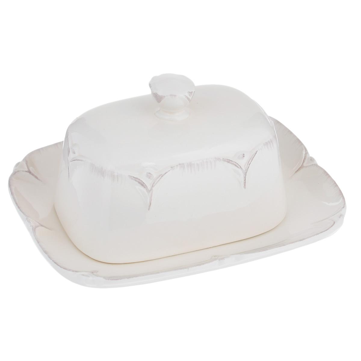 Масленка Lillo Ideal, цвет: молочный115510Масленка Lillo Ideal, изготовленная из керамики, предназначена для красивой сервировки и хранения масла. Она состоит из крышки с удобной ручкой и подноса. Масло в ней долго остается свежим, а при хранении в холодильнике не впитывает посторонние запахи. Гладкая поверхность обеспечивает легкую чистку. Можно мыть в посудомоечной машине. Размер подноса: 18,5 см х 14,5 см х 2,5 см. Размер крышки: 13 см х 9 см х 9 см.