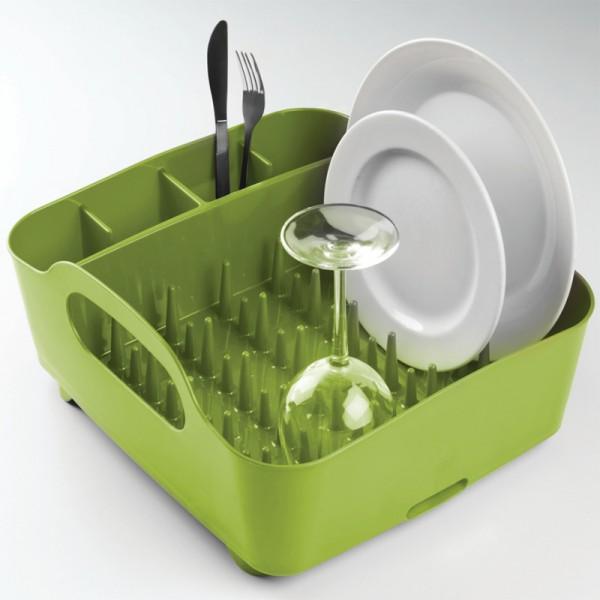 Сушилка для посуды Umbra Tub, цвет: зеленый, 34,5 см х 37 см х 18 см330590-806Сушилка для посуды Umbra Tub выполнена из полипропилена - высокопрочного нескользящего материала. Компактный дизайн изделия создает огромное пространство для хранения и сушки посуды. Несколько отсеков, которые позволяют уместить приборы, чашки, тарелки, и при этом они все будут на своем месте. В ней даже можно сушить бокалы и стаканы, благодаря специальным шипам, они не будут скользить. Сушилка ставится прямо в раковину. Благодаря ножкам, вода не будет застаиваться под сушилкой. Для удобства переноски изделие имеет удобные ручки.Размер сушилки: 34,5 см х 37 см х 18 см.