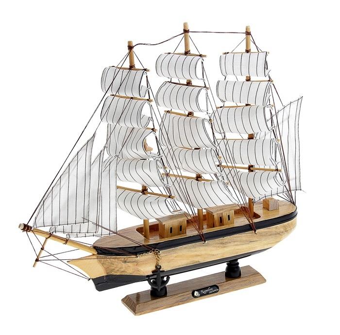Корабль сувенирный Корабль мечты, длина 40 см. 564183Брелок для ключейСувенирный корабль Корабль мечты, изготовленный из дерева и текстиля, это великолепный элемент декора рабочей зоны в офисе или кабинете. Корабль с парусами и якорями помещен на деревянную подставку. Время идет, и мы становимся свидетелями развития технического прогресса, новых учений и практик. Но одно не подвластно времени - это любовь человека к морю и кораблям. Сувенирный корабль наполнен историей и силой океанских вод. Данная модель кораблика станет отличным подарком для всех любителей морей, поклонников историй о покорении океанов и неизведанных земель. Модель корабля - подарок со смыслом. Издавна на Руси считалось, что корабли приносят удачу и везение. Поэтому их изображения, фигурки и точные копии всегда присутствовали в помещениях. Удивите себя и своих близких необычным презентом.