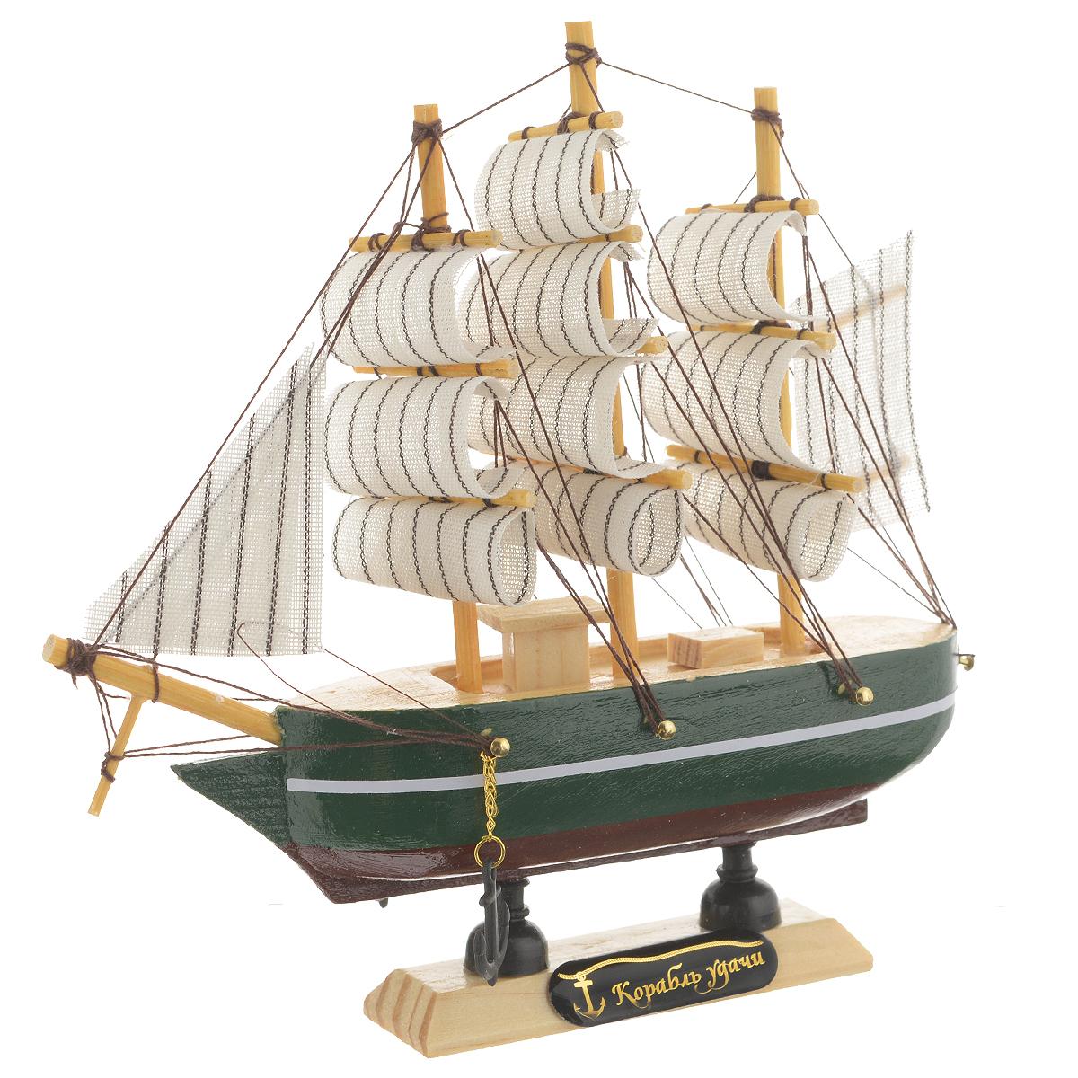 Корабль сувенирный Корабль удачи, длина 16 см. 56416974-0060Сувенирный корабль Корабль удачи, изготовленный из дерева и текстиля, это великолепный элемент декора рабочей зоны в офисе или кабинете. Корабль с парусами и якорями помещен на деревянную подставку. Время идет, и мы становимся свидетелями развития технического прогресса, новых учений и практик. Но одно не подвластно времени - это любовь человека к морю и кораблям. Сувенирный корабль наполнен историей и силой океанских вод. Данная модель кораблика станет отличным подарком для всех любителей морей, поклонников историй о покорении океанов и неизведанных земель. Модель корабля - подарок со смыслом. Издавна на Руси считалось, что корабли приносят удачу и везение. Поэтому их изображения, фигурки и точные копии всегда присутствовали в помещениях. Удивите себя и своих близких необычным презентом.
