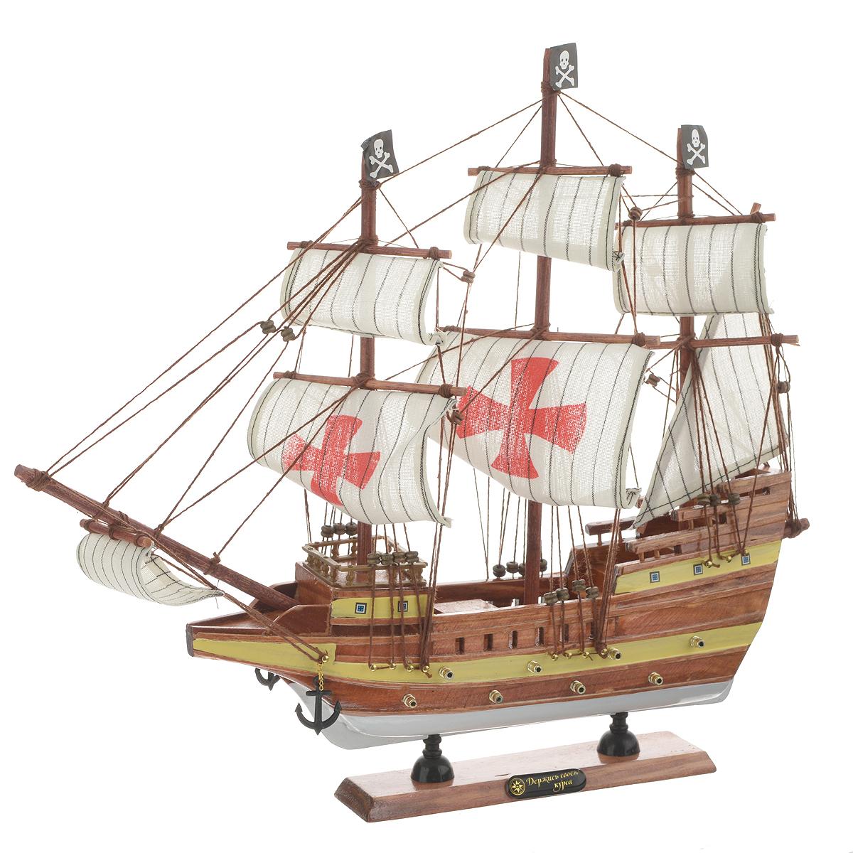 Корабль сувенирный Держись своего курса, длина 40 смa030071Сувенирный корабль Держись своего курса, изготовленный из дерева и текстиля, это великолепный элемент декора рабочей зоны в офисе или кабинете. Корабль с парусами и якорями помещен на деревянную подставку. Время идет, и мы становимся свидетелями развития технического прогресса, новых учений и практик. Но одно не подвластно времени - это любовь человека к морю и кораблям. Сувенирный корабль наполнен историей и силой океанских вод. Данная модель кораблика станет отличным подарком для всех любителей морей, поклонников историй о покорении океанов и неизведанных земель. Модель корабля - подарок со смыслом. Издавна на Руси считалось, что корабли приносят удачу и везение. Поэтому их изображения, фигурки и точные копии всегда присутствовали в помещениях. Удивите себя и своих близких необычным презентом.