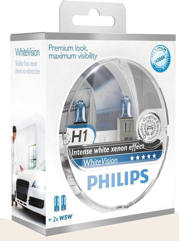 Лампа автомобильная галогенная Philips WhiteVision, для фар, цоколь H1 (P14.5s), 12V, 55W, 2 шт + цоколь W5W, 12V, 5W, 2 шт10503Галогенная лампа для автомобильных фар Philips WhiteVision произведена из запатентованного кварцевого стекла с УФ фильтром Philips Quartz Glass. Кварцевое стекло Philips в отличие от обычного твердого стекла выдерживает гораздо большее давление смеси газов внутри колбы, что препятствует быстрому испарению вольфрама с нити накаливания. Кварцевое стекло выдерживает большой перепад температур, при попадании влаги на работающую лампу изделие не взрывается и продолжает работать. Лампы Philips WhiteVision излучают интенсивный белый свет с ксеноновым эффектом, что создает идеальные условия для вождения в ночное время. Благодаря повышенной яркости и цветовой температуре до 4300К лампы мгновенно рассеивают темноту: яркость чистого белого света увеличена на 40%. Повышенный уровень безопасности: более длинный световой пучок и на 60% больше света. Это обеспечивает лучшую видимость на дороге и позволяет предотвращать потенциально аварийные ситуации. Обладая цветовой температурой ксеноновых ламп и стильным белым цоколем, лампы WhiteVision идеально подходят для головного освещения.Автомобильные галогенные лампы Philips удовлетворят все нужды автомобилистов: дальний свет, ближний свет, передние противотуманные фары, передние и боковые указатели поворота, задние указатели поворота, стоп-сигналы, фонари заднего хода, задние противотуманные фонари, освещение номерного знака, задние габаритные/стояночные фонари, освещение салона.