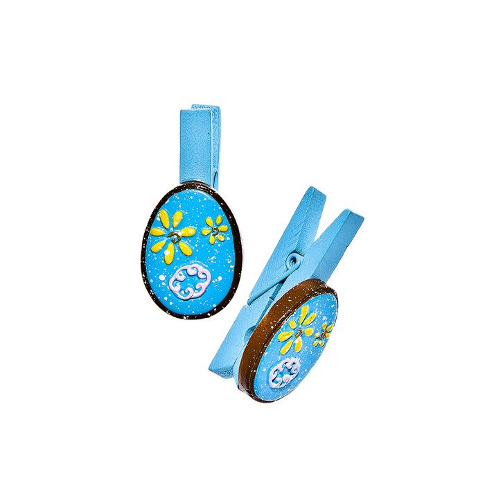 Набор декоративных прищепок Home Queen Весенние цветы, цвет: голубой, 6 шт64409_7Набор Home Queen Весенние цветы состоит из шести декоративных прищепок. Прищепки выполнены из высококачественного дерева и декорированы фигурками яиц, выполненных из полирезины и украшенных рельефом. Изделия используются для развешивания стикеров на веревке, маленьких игрушек, а оригинальность и веселые цвета прищепок будут радовать глаз и поднимут настроение.Длина прищепки: 4,5 см. Размер фигурки: 3 см х 0,5 см х 2,2 см.