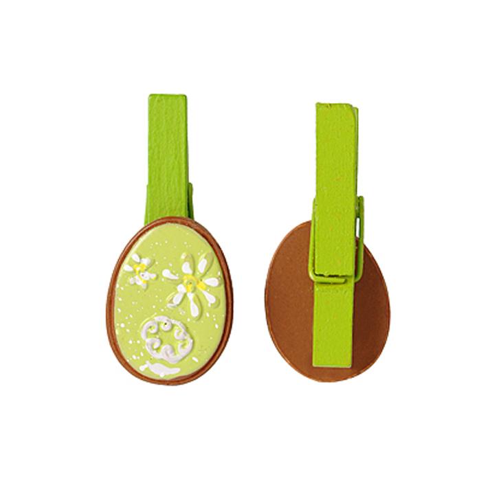 Набор декоративных прищепок Home Queen Весенние цветы, цвет: зеленый, 6 шт35492Набор Home Queen Весенние цветы состоит из шести декоративных прищепок. Прищепки выполнены из высококачественного дерева и декорированы фигурками яиц, выполненных из полирезины и украшенных рельефом. Изделия используются для развешивания стикеров на веревке, маленьких игрушек, а оригинальность и веселые цвета прищепок будут радовать глаз и поднимут настроение.Длина прищепки: 4,5 см. Размер фигурки: 3 см х 0,5 см х 2,2 см.