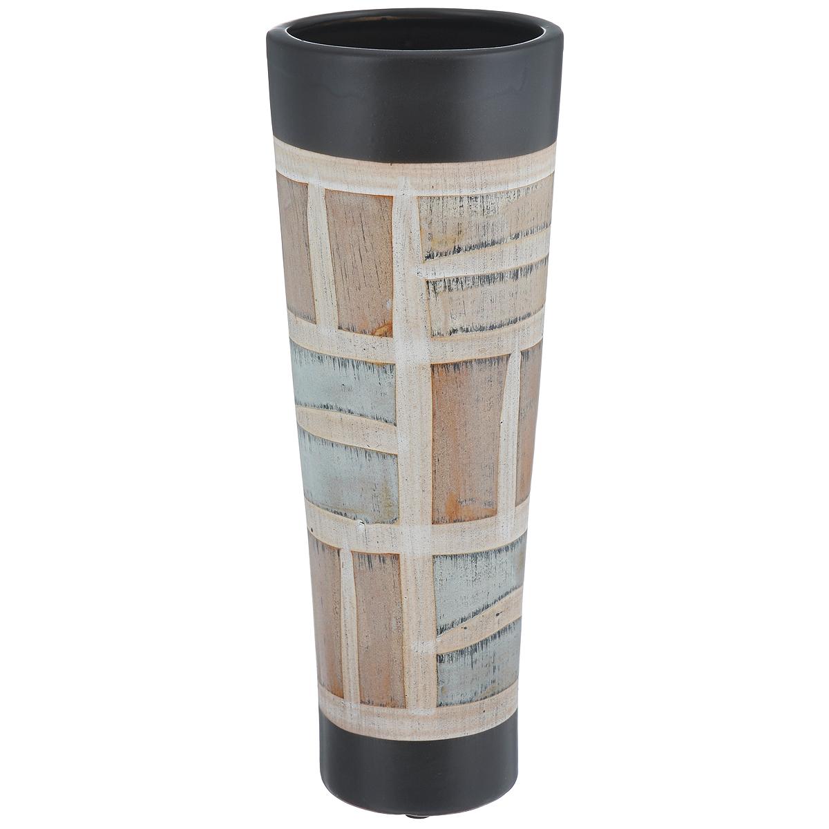 Ваза декоративная Геометрический орнамент, высота 29,5 см8KG34/0/99T42/355Элегантная ваза Геометрический орнамент, выполненная из высококачественного глазурованного фаянса, геометрическим орнаментом. Изделие оснащено резиновыми ножками, предотвращающими скольжение вазы по поверхности. Оригинальный дизайн вазы Геометрический орнамент придется по вкусу и ценителям классики, и тем, кто предпочитает утонченность и изящность. Вы можете поставить вазу в любом месте, где она будет удачно смотреться и радовать глаз. Такая ваза подойдет и для цветов, и для декора интерьера. Кроме того - это отличный вариант подарка для ваших близких и друзей. Диаметр вазы (по верхнему краю): 11 см. Высота вазы: 29,5 см.