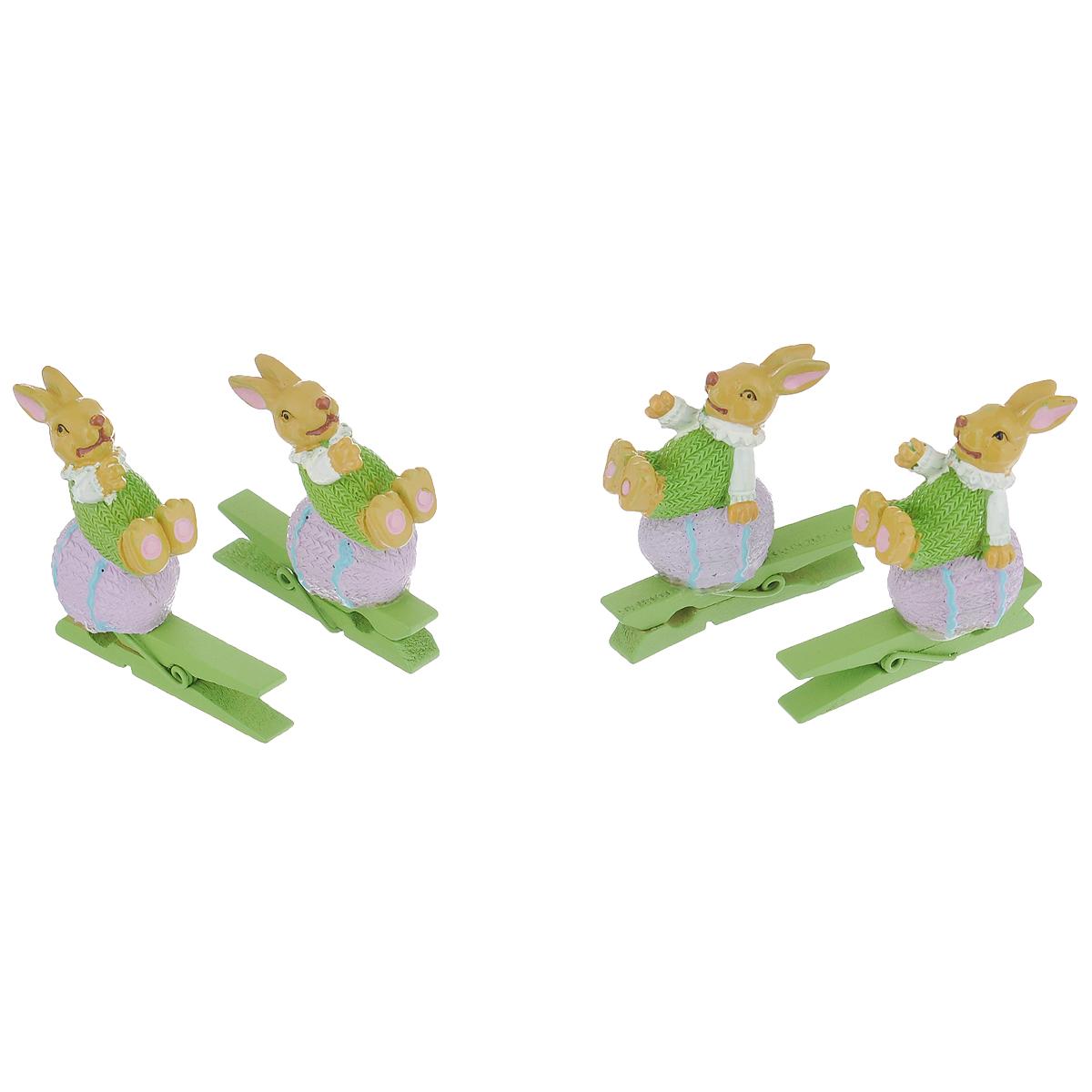 Набор декоративных прищепок Феникс-презент Кролики, 4 штМ1307Набор Феникс-презент Кролики состоит из 4 декоративных прищепок, выполненных из дерева. Прищепки оформлены декоративными фигурками из полирезины в виде забавных кроликов на пасхальных яйцах. Изделия используются для развешивания стикеров на веревке, маленьких игрушек, а оригинальность и веселые цвета прищепок будут радовать глаз и поднимут настроение.Размер прищепки: 4,5 см х 2 см х 4 см.