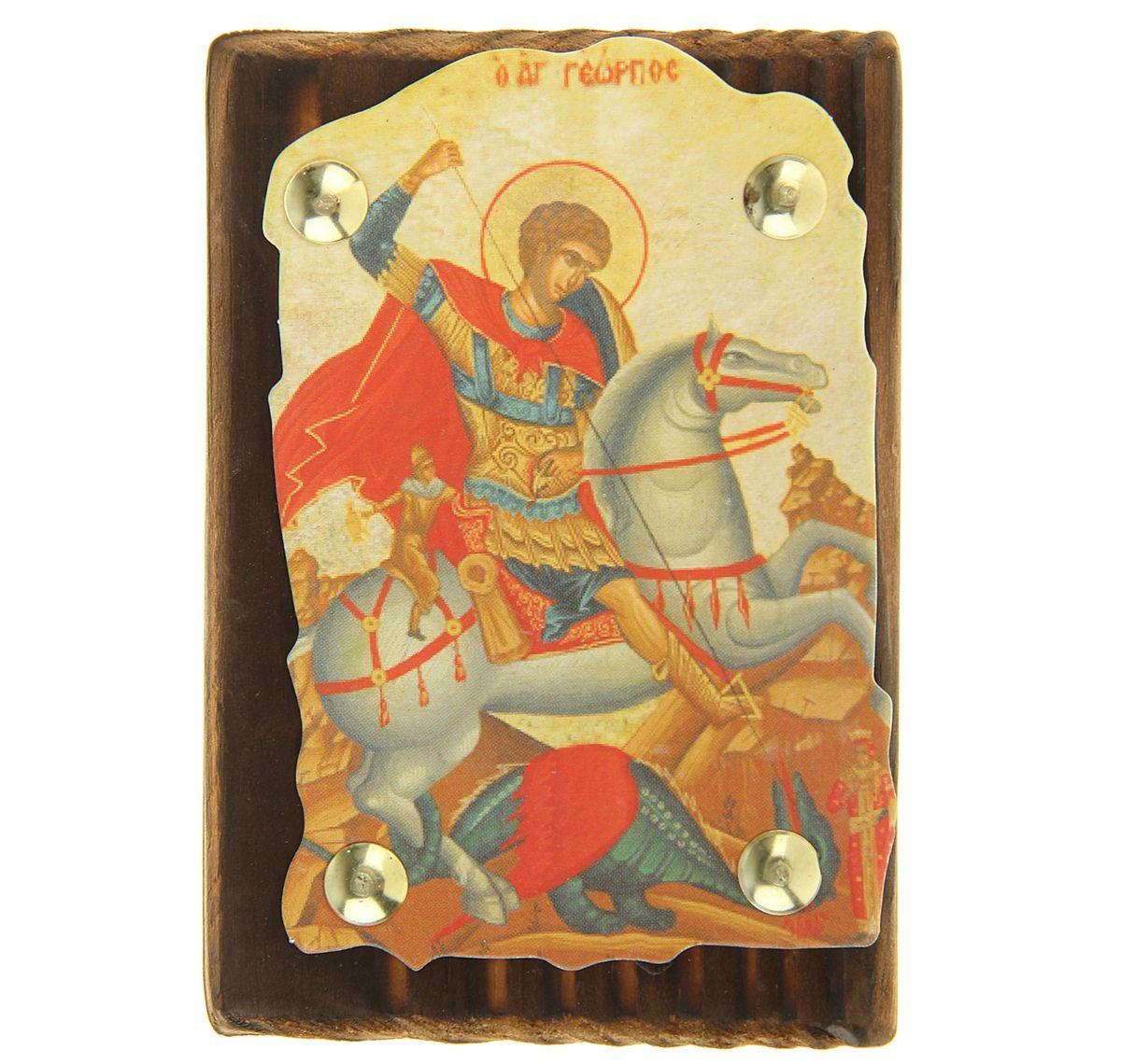 Икона Георгий Победоносец, 7,5 см х 11 смFS-80299Икона Георгий Победоносец выполнена из картона, с нанесенным изображением, который крепиться на деревянную дощечку, обработанную огнем. На обратной стороне имеется отверстие, благодаря которому икону удобно вешать на стену. Изображенный образ полностью соответствует канонам Русской Православной Церкви. Такая икона будет прекрасным подарком с духовной составляющей.