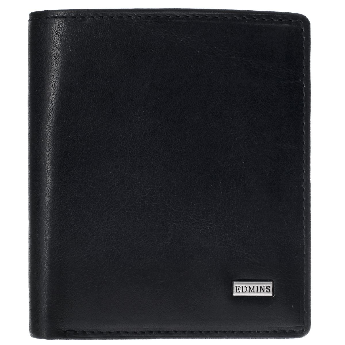 Портмоне женское EdminsW16-11135_914Женское портмоне Edmins выполнено из натуральной кожи с глянцевой поверхностью. Лицевая сторона оформлена небольшой металлической пластиной с гравировкой Edmins. Портмоне закрывается клапаном на кнопку. Внутри расположены два отделения для купюр, три прорезных кармана для пластиковых карт и визиток, два потайных кармана и отделения для мелочи на застежке-кнопке. С внутренней стороны портмоне оформлено тиснением в виде логотипа бренда.Портмоне упаковано в фирменную коробку с логотипом бренда.Такое стильное портмоне станет отличным подарком для человека, ценящего качественные и необычные вещи.