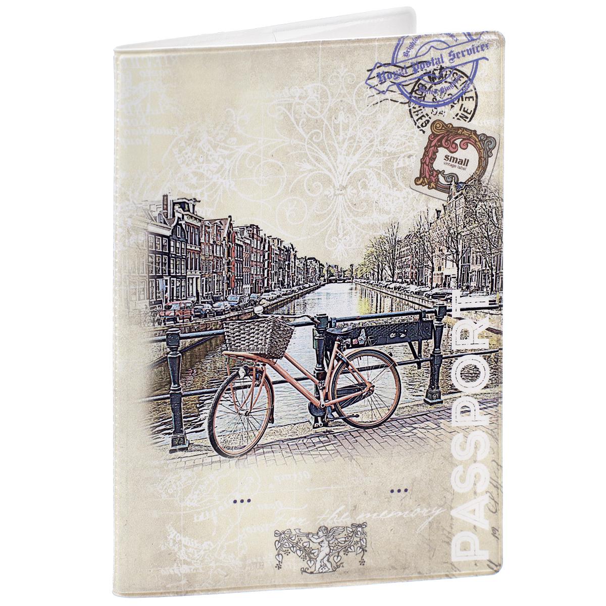 Обложка для паспорта Велосипед, цвет: бежевый. 32401W16-12123_811Обложка для паспорта Велосипед не только поможет сохранить внешний вид ваших документов и защитить их от повреждений, но и станет стильным аксессуаром, идеально подходящим вашему образу. Обложка выполнена из поливинилхлорида и оформлена оригинальным изображением велосипеда, стоящего на набережной. Внутри имеет два вертикальных кармана из прозрачного пластика. Такая обложка поможет вам подчеркнуть свою индивидуальность и неповторимость!