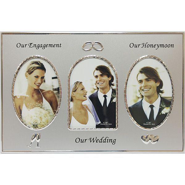 """Фоторамка Наша Свадьба, цвет: серебристый, на 3 фото, 10 х 15 см 9511712723Оригинальная рамка для фотографий """"Наша свадьба"""" позволит запечатлеть один из самых знаменательных и счастливых дней вашей жизни - день бракосочетания. Рамка позволит вам разместить три фотографии форматом 10 см х 15 см. Фоторамка выполнена из металла серебристого цвета и оформлена выпуклым изображением сердечек, бокалов и обручальных колец. Такая рамка послужит замечательным подарком ко дню свадьбы, а также великолепно оформит интерьер. Характеристики:Материал: пластик, стекло. Размер рамки:35,5 см х 24 см х 1 см. Размер фотографии:10 см х 15 см. Размер упаковки: 37 см х 25 см х 1,5 см.Артикул: 95117."""