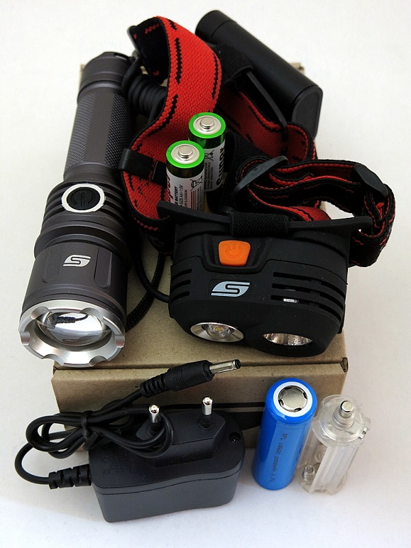 Набор фонарей SOLARIS Kit FZ-50/M40 с комплектациейKOCAc6009LEDНабор фонарей состоит из ручного туристического фонаря SOLARIS FZ-50 и налобного фонаря SOLARIS M40. Такое сочетание позволяет решать многие задачи по освещению в походе, на рыбалке, на даче: - Дальнобойный фонарь SOLARIS FZ-50 c функцией фокусировки - для освещения дальних объектов, в качестве поискового и т.д. - Налобный фонарь SOLARIS M40 с 2-мя рефлекторами - пригодится везде, где нужны свободные руки, для освещения близких и среднеудаленных объектов. ОПИСАНИЕ ФОНАРЯ SOLARIS FZ-50:Мощный дальнобойный светодиодный фонарь, с функцией фокусировки (ZOOM) и встроенным портом подзарядки. Фонарь выполнен из авиационного алюминия с III (наивысшей) степенью защитного анодирования корпуса. Влагозащищенный — стандарт IPX6. Фонарь снабжен современным светодиодом СREE XP-E R3 (США). Мощность светового потока 180 люмен, дальность эффективного излучения света 250 метров. Размеры/вес фонаря: 145мм * 37мм; 130грамм (без батарей). В этом фонаре отлично реализована оптическая система ZOOM: - при минимальном фокусном расстоянии - очень широкий диаметр светового пятна;- при максимально выдвинутой головной части - фонарь выдает узкий и дальнобойный луч света.ОПИСАНИЕ НАЛОБНОГО ФОНАРЯ SOLARIS M40: Мощный высококачественный налобный светодиодный фонарь, с двумя рефлекторами - для дальнего и ближнего света. Корпус фонаря выполнен из противоударного ABS пластика. Водозащищенный — стандарт IPX6. Особенность фонаря: 2 специализированных диффузора-рефлектора. - Параболический рефлектор дальнего света снабжен современным светодиодом CREE XR-E R2 (США). Мощность светового потока 160 люмен, дальность освещения 120 метров. - Рефлектор ближнего света снабжен куполообразной линзой для лучшего рассеивания света и светодиодом мощностью 3 ватта. Широкое панорамное освещение в радиусе 10-15 метров. Комплектация: - Фонарь SOLARIS FZ-50 - Фонарь SOLARIS M40 - 1 / 18650 литий-ионовый аккумулятор 3,7в 2000мАч (для FZ-50) - 2 / АА батареи (для
