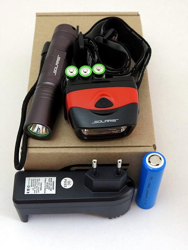 Набор фонарей SOLARIS Kit F-30/L20 с комплектациейKOCAc6009LEDНабор фонарей состоит из ручного туристического фонаря SOLARIS F-30 и налобного фонаря SOLARIS L20. Такое сочетание позволяет решать многие задачи по освещению в походе, на рыбалке, на даче: - Компактный фонарь SOLARIS F-30 - для освещения среднеудаленных объектов, удобен в качестве карманного фонаря. - Налобный фонарь SOLARIS L20 - пригодится везде, где нужны свободные руки, для освещения близких объектов. ОПИСАНИЕ ФОНАРЯ SOLARIS F-30: Мощный компактный светодиодный фонарь, подходит для ежедневного ношения в качестве карманного. Фонарь выполнен из авиационного алюминия с III (наивысшей) степенью защитного анодирования корпуса. Влагозащищенный — стандарт IPX8. Фонарь снабжен современным светодиодом СREE XP-E R3 (США). Встроенный стабилизатор напряжения. Мощность светового потока 150 люмен, дальность эффективного излучения света 150 метров. Размеры/вес фонаря: 118мм *24мм; 60грамм (без батареи). Световой поток фонаря максимально сбалансирован - фонарем удобно пользоваться как на дальней, так и на ближней дистанции. Выключенный фонарь легко найти в темноте - благодаря флюоресцентной вставке в головной части. Компактные размеры и отсутствие выступающих частей делают фонарь максимально удобным для ношения в кармане.ОПИСАНИЕ НАЛОБНОГО ФОНАРЯ SOLARIS L20: Простой и эффективный высококачественный налобный светодиодный фонарь, с повышенным временем автономной работы. Корпус фонаря выполнен из противоударного ABS пластика. Водозащищенный — стандарт IPX5. 1-я особенность фонаря: Фонарь снабжен 5-ю современным светодиодами и коническим пирамидальным отражателем, благодаря чему достигается широкий угол рассеивания света и достаточная яркость. Очень удобен для работы на ближней дистанции. 2-я особенность фонаря: Благодаря экономичным светодиодам и мощному электропитанию (3 батарейки ААА), фонарь имеет повышенное время автономной работы без замены батареек - до 20 часов в максимальном режиме. Комплектация: - Фонарь SOL