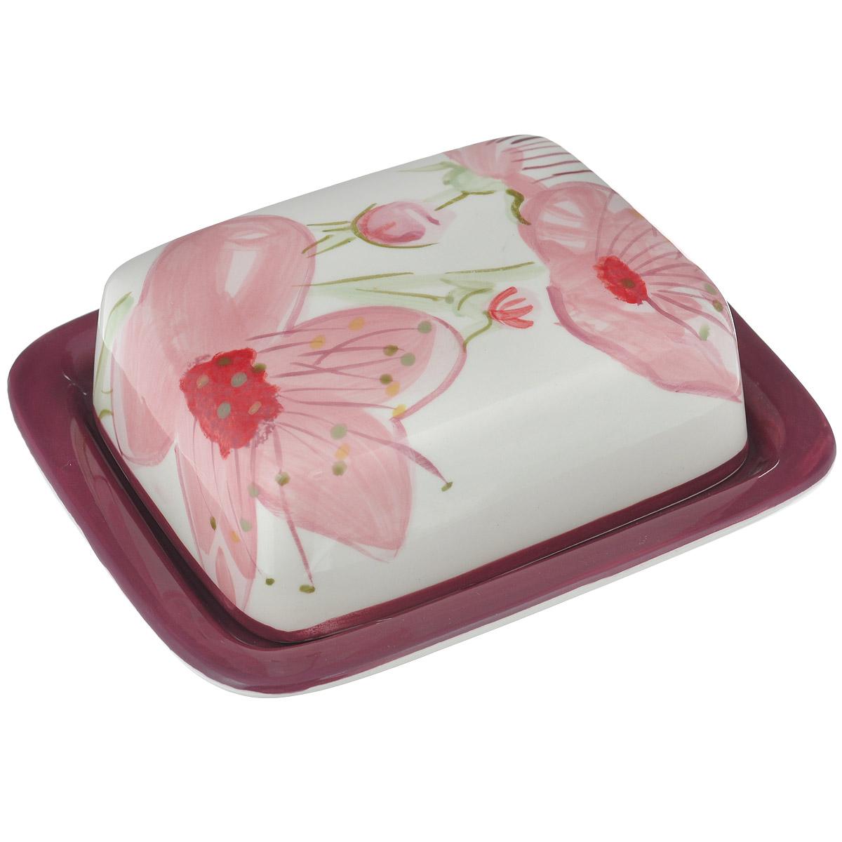 Масленка Вишня, 17,5 х 14,5 см115510Масленка Вишня, выполненная из высококачественной керамики, предназначена для красивой сервировки и хранения масла. Она состоит из подноса и крышки, оформленных изображением цветков вишни. Поднос имеет специальные выемки, благодаря которым крышка легко на него устанавливается. Масло в такой масленке долго остается свежим, а при хранении в холодильнике не впитывает посторонние запахи. Масленка Вишня станет незаменимой на вашей кухне.Размер подноса: 20 см х 12 см.Размер крышки: 13,8 см х 11 см х 4,5 см.