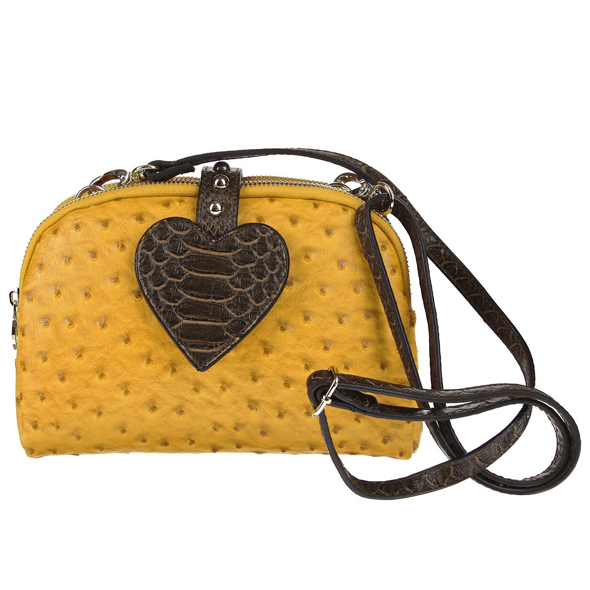 Сумка женская Dino Ricci, цвет: желтый, коричневый. 2026-43-1101225Сумка от Dino Ricci отлично подчеркнет ваш повседневный образ. Модель из искусственной кожи с рельефной фактурой под кожу страуса, закрывающаяся клапаном на магнитной кнопке. Клапан выполнен в виде сердца, украшен выпуклыми металлическими клепками. Два отделения, скрепленные между собой кнопкой, каждое из которых закрывается на молнию. Все язычки молний украшены логотипом бренда. Врезной внешний карман, также закрывающийся на молнию. Подкладка выполнена из полиэстера. Ремешок для ношения на плече крепится карабинами к петелькам между отделениями сумки. Длина ремешка регулируется. Максимальная длина: 132 см. Минимальная длина: 66 см.