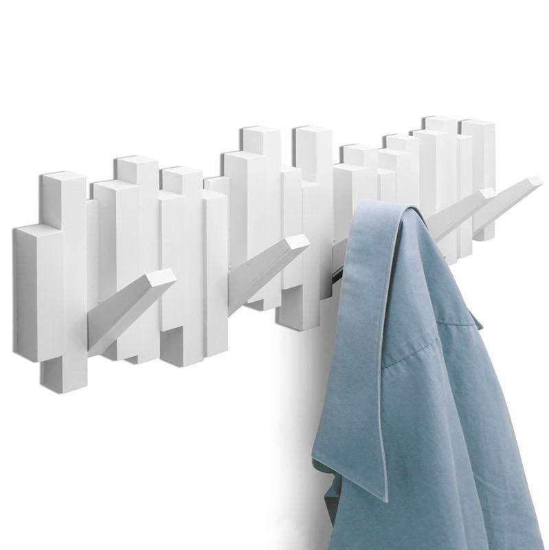 Вешалка настенная Umbra Sticks, цвет: белый, 5 крючковBW-4752Стильная и прочная вешалка Umbra Sticks интересной формы и оригинального дизайна изготовлена из прочного пластика. Имеет 5 откидных и прочных крючков. Когда они не используются, то складываются, превращая конструкцию в плоский декоративный элемент стильной формы. Вешалка Umbra Sticks идеально подходит для маленьких прихожих и ограниченных пространств. Каждый крючок выдерживает вес до 2,3 кг. Размер вешалки: 50 см х 17 см х 2 см.