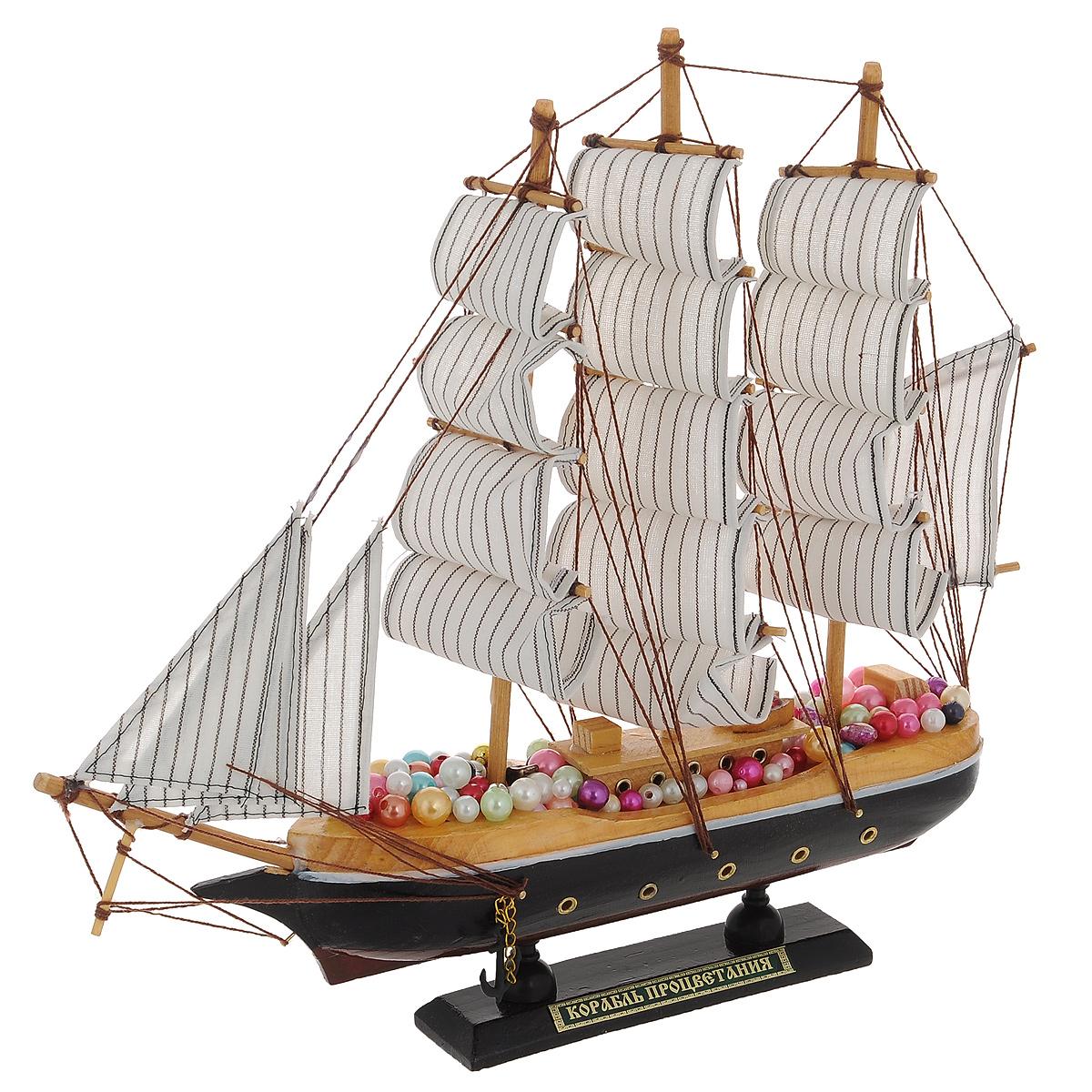 Корабль сувенирный Корабль процветания, длина 33 см41619Сувенирный корабль Корабль процветания, изготовленный из дерева, металла и текстиля, это великолепный элемент декора рабочей зоны в офисе или кабинете. Корабль с парусами и якорями помещен на деревянную подставку. Палуба корабля украшена разноцветными бусинами. Время идет, и мы становимся свидетелями развития технического прогресса, новых учений и практик. Но одно не подвластно времени - это любовь человека к морю и кораблям. Сувенирный корабль наполнен историей и силой океанских вод. Данная модель кораблика станет отличным подарком для всех любителей морей, поклонников историй о покорении океанов и неизведанных земель. Модель корабля - подарок со смыслом. Издавна на Руси считалось, что корабли приносят удачу и везение. Поэтому их изображения, фигурки и точные копии всегда присутствовали в помещениях. Удивите себя и своих близких необычным презентом.Размер корабля (с учетом подставки): 33 см х 6 см х 32 см.