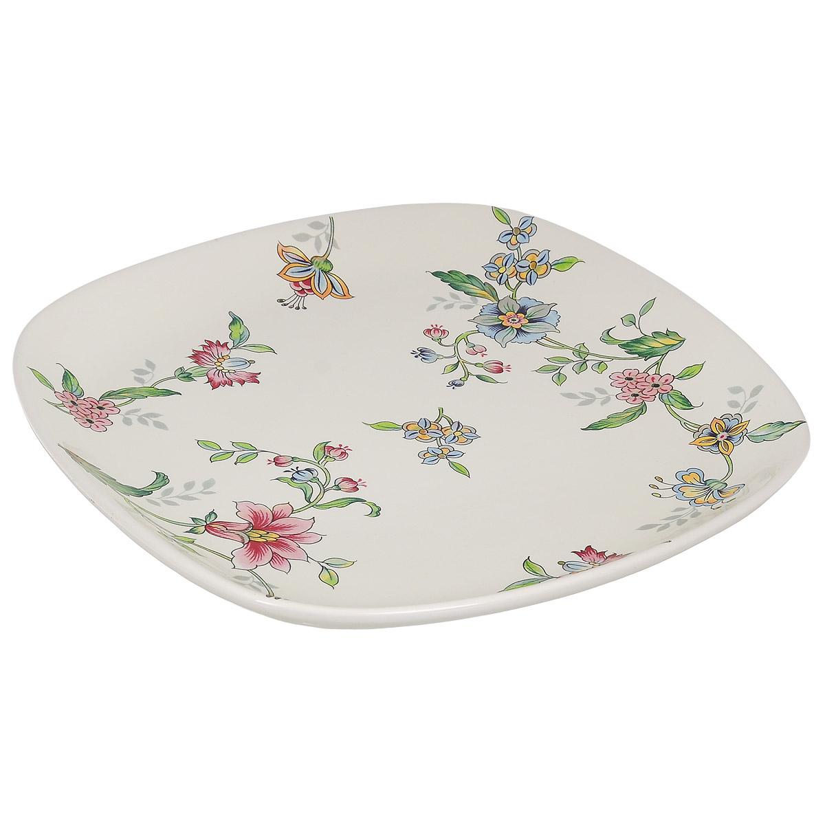 Тарелка Nuova Cer Прованс, 25,5 см х 25,5 см60690Изящная тарелка Nuova Cer Прованс изготовлена из высококачественной керамики. Изделие оформлено красочным изображением цветов. Предназначена для сервировки закусок и различных блюд, а также для подачи вторых блюд. Оригинальная тарелка прекрасно оформит стол и порадует вас лаконичным и ярким дизайном.Можно использовать в микроволновой печи и мыть в посудомоечной машине.Размер тарелки (по верхнему краю): 25,5 см х 25,5 см.Высота тарелки: 3,3 см.
