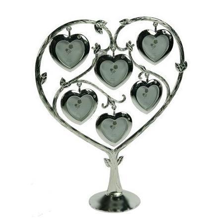 Декоративная фоторамка Сердце, на 6 фото. 26400725975Декоративная фоторамка Сердце выполнена из металла серебристого цвета. На подставку в виде дерева подвешены 6 рамочек в форме сердца, украшенных стразами. Изысканная и эффектная, эта потрясающая рамочка покорит своей красотой и изумительным качеством исполнения. Декоративная фоторамка Сердце не только украсит интерьер помещения, но и внесет нотки изысканности и оригинальности.